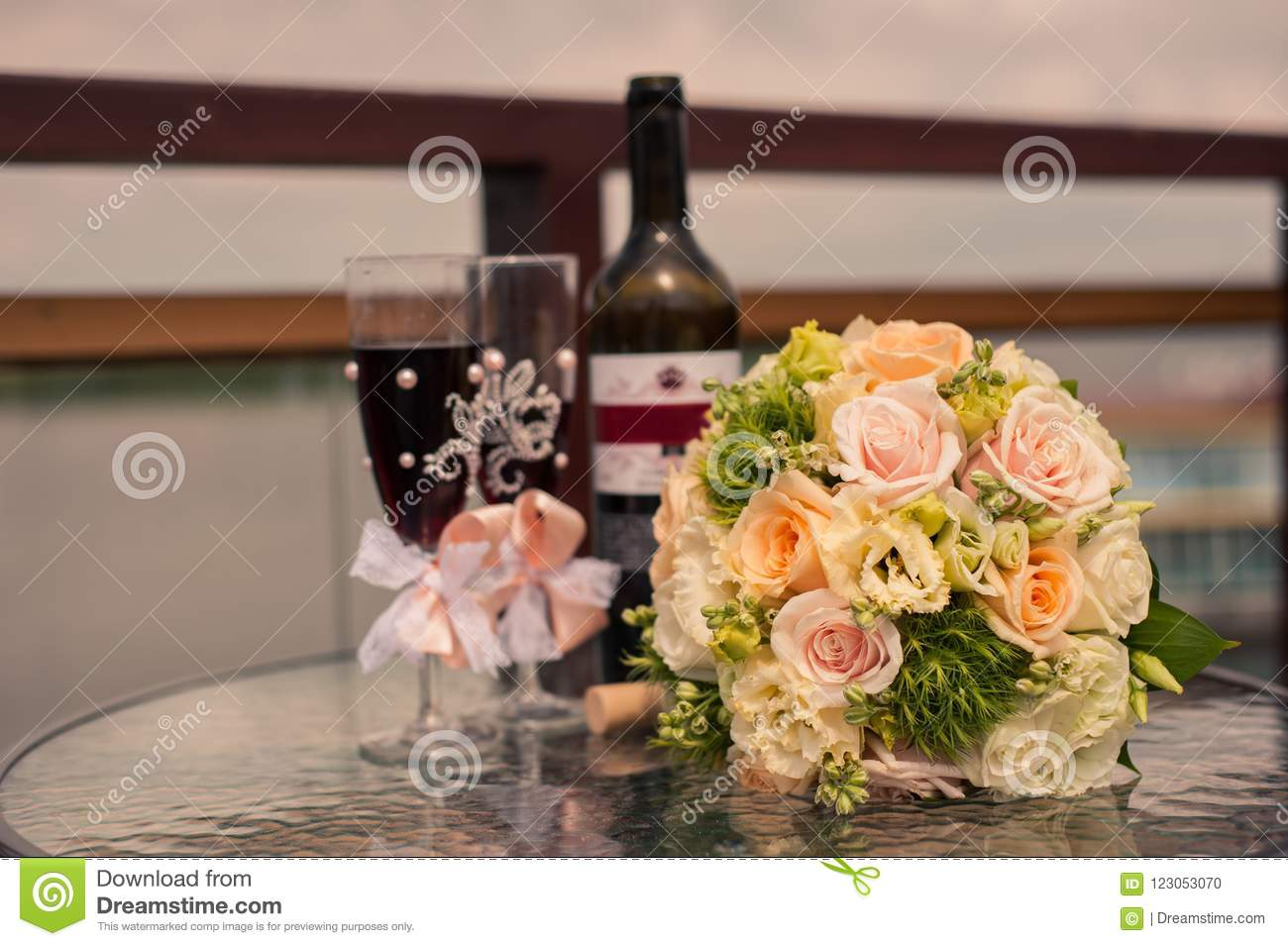 White And Green Wedding Bouquet And Glasses With Bottle Of Wine