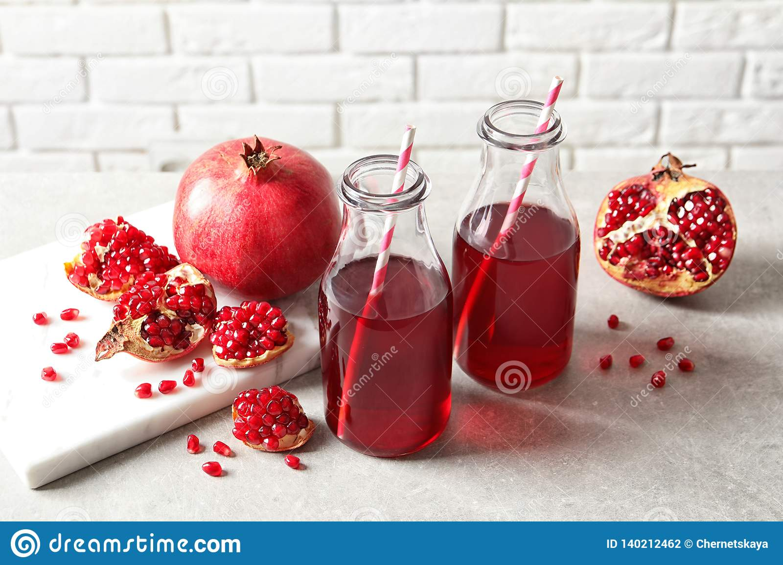 Composition with bottles of fresh pomegranate juice