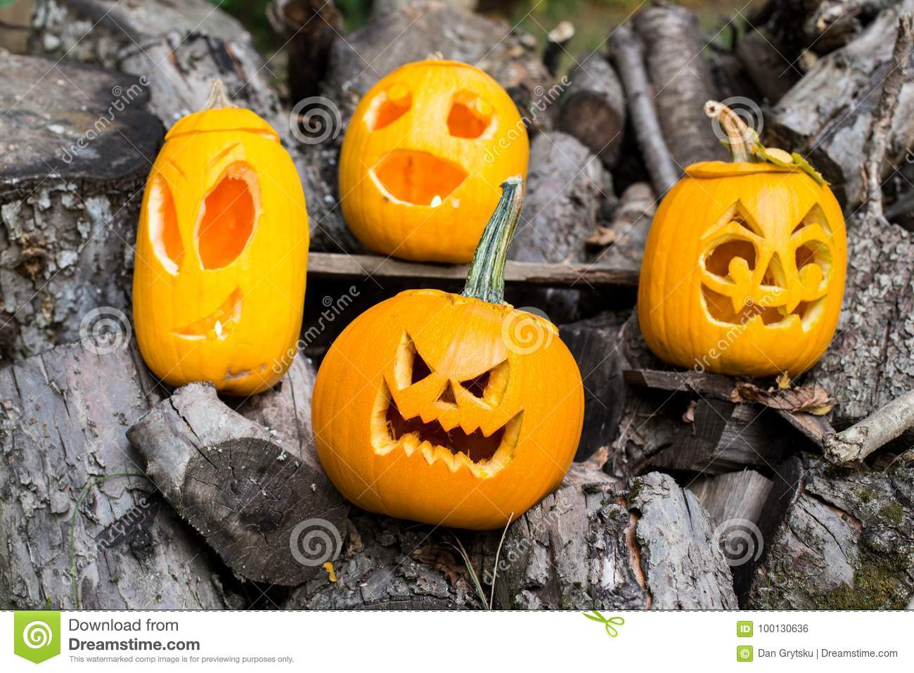 halloween themes composition of four carved halloween pumpkins on
