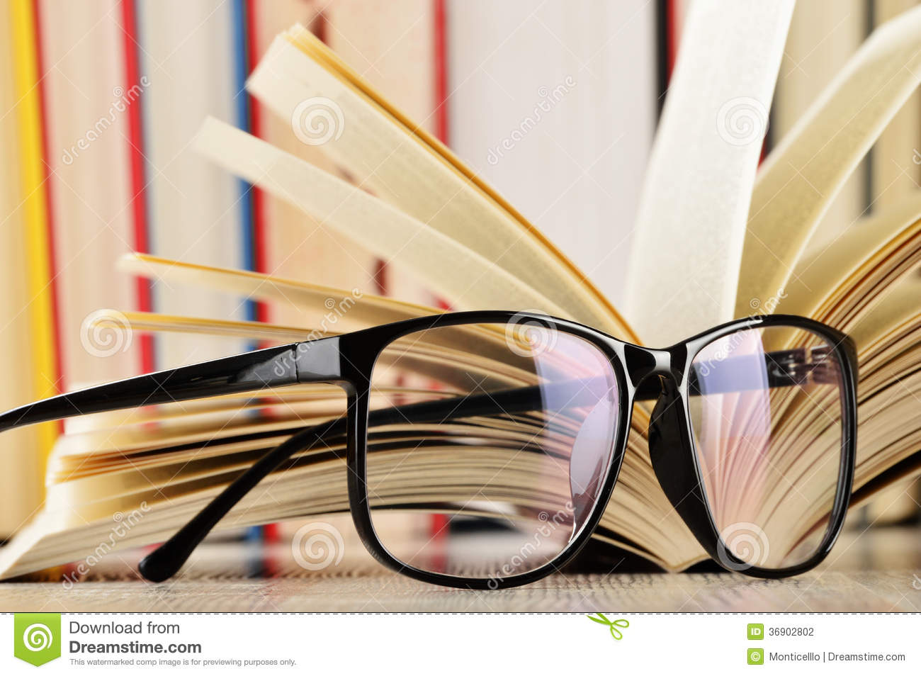 glasses on book - photo #17