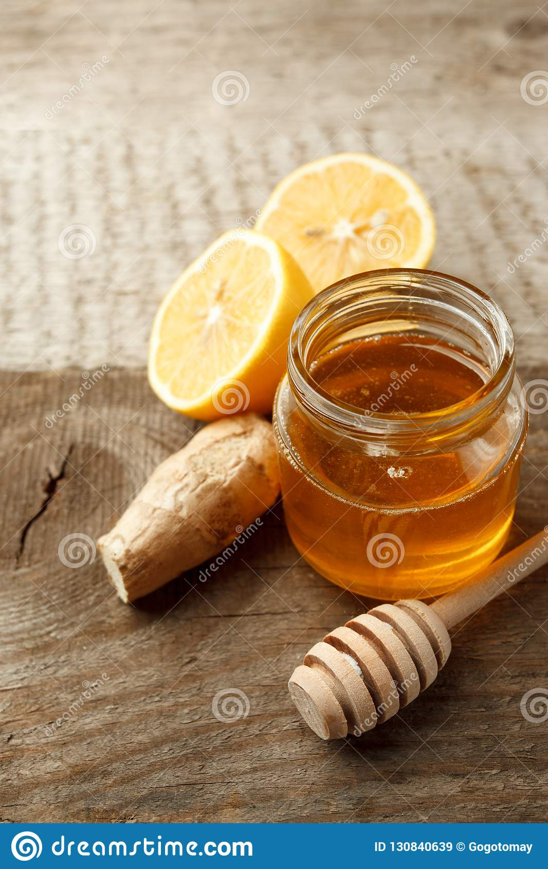 Ingredients for herbal medicine lemon, ginger, honey. Natural products to support the immune system in winter, vintage wooden back