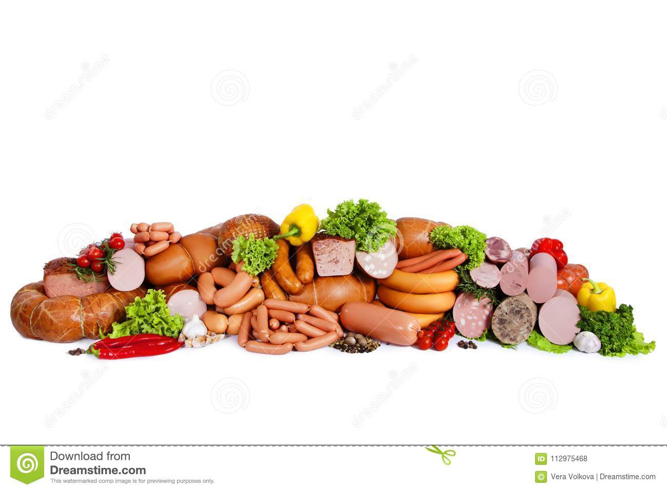 Composition from meat products. Decorated with vegetables and leaves of green salad. Isolated on white background
