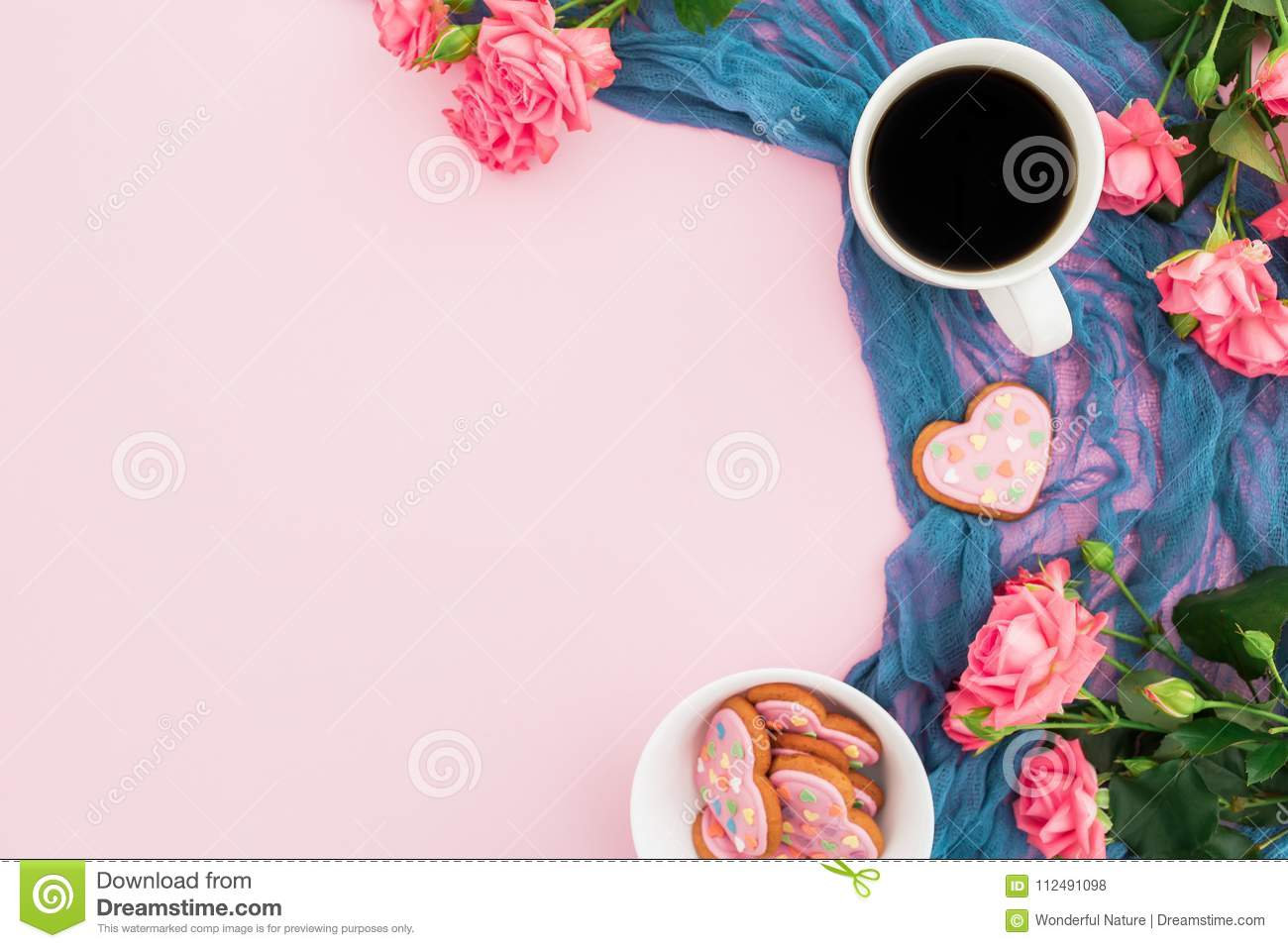 Composition With Roses Flowers Cookies And Cup Of Coffee On Pink