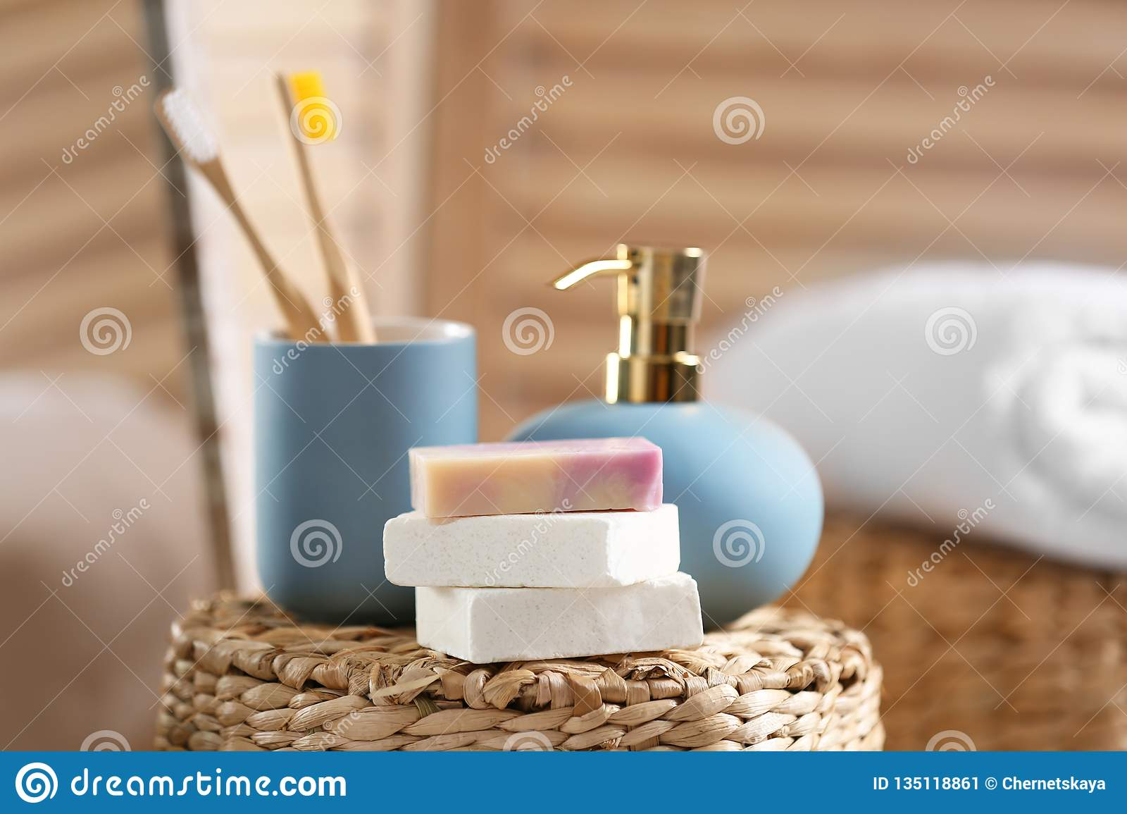 Composition with soap and toiletries on wicker basket