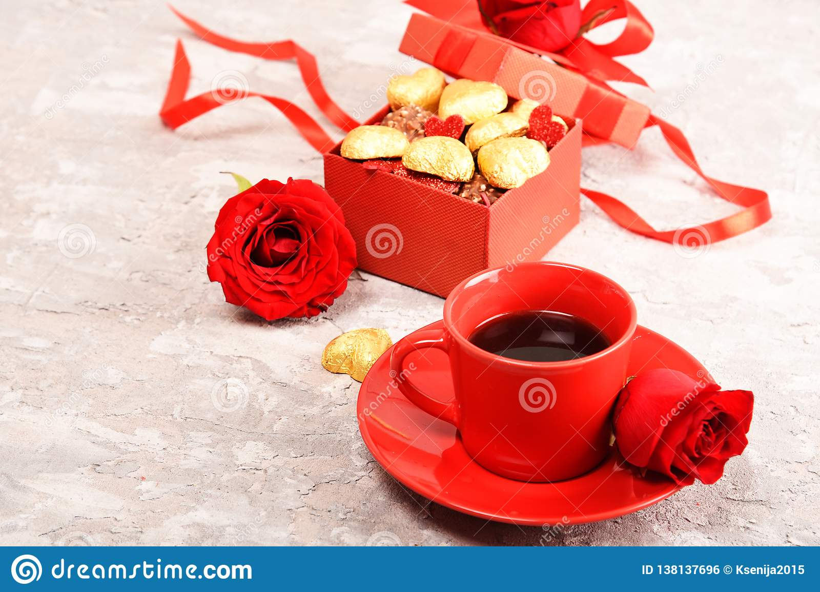 Composition for Valentine`s Day. Roses, gift, glasses and wine, red hearts. Top view.
