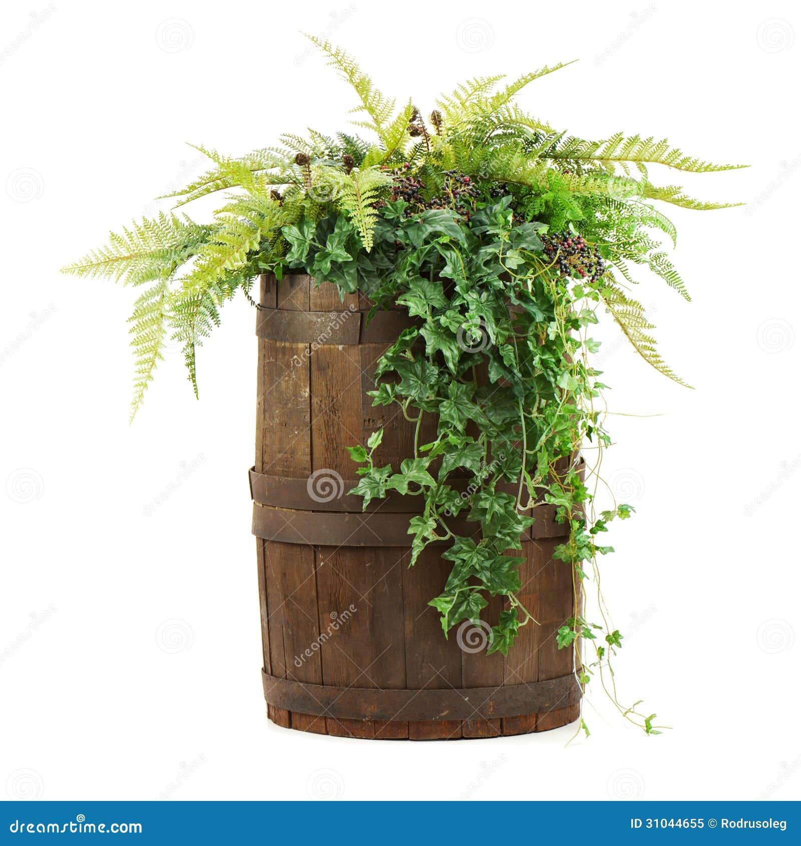 Composizione dei fiori artificiali in vecchio barilotto di for Mazzo per esterni in legno
