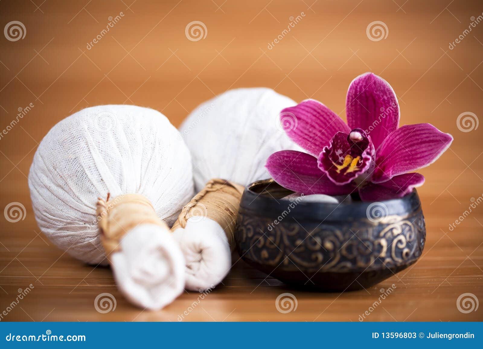 Compresas de la orquídea y del masaje