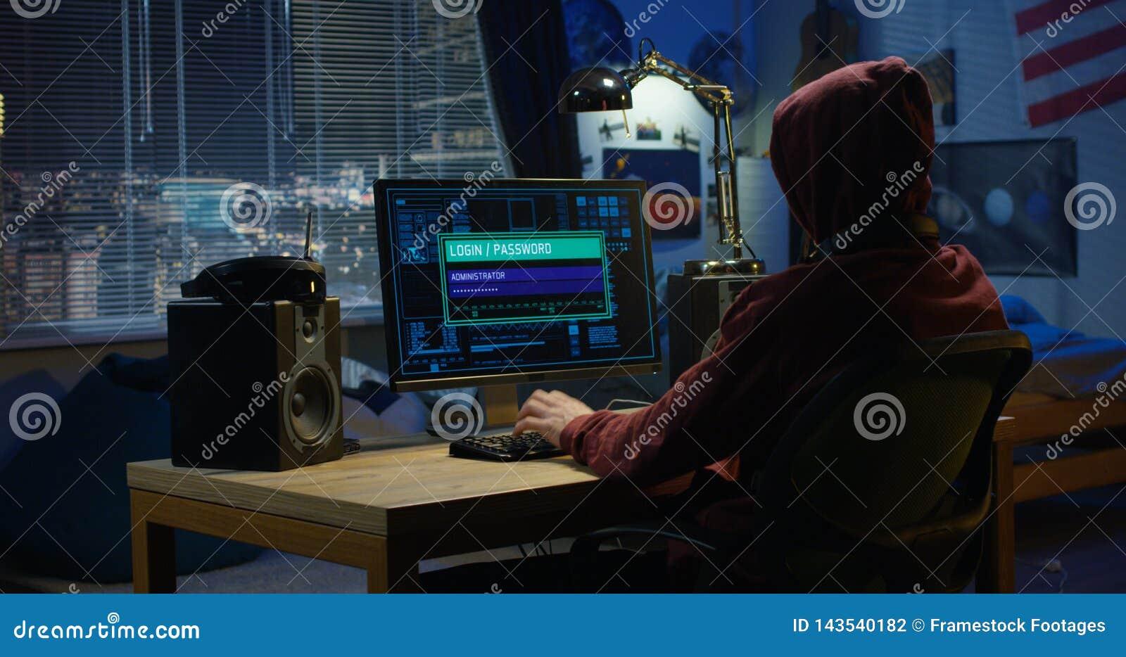 Computer hacker using his computer