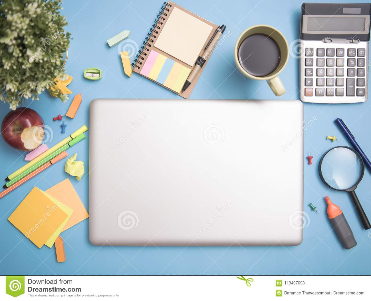 computer notebook laptop on desktop and school stationery stock