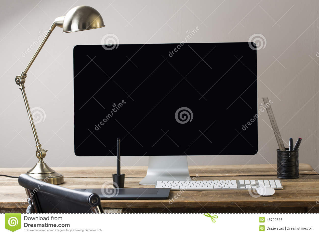 Computer Screen And Keyboard And Mouse On A Wood Table