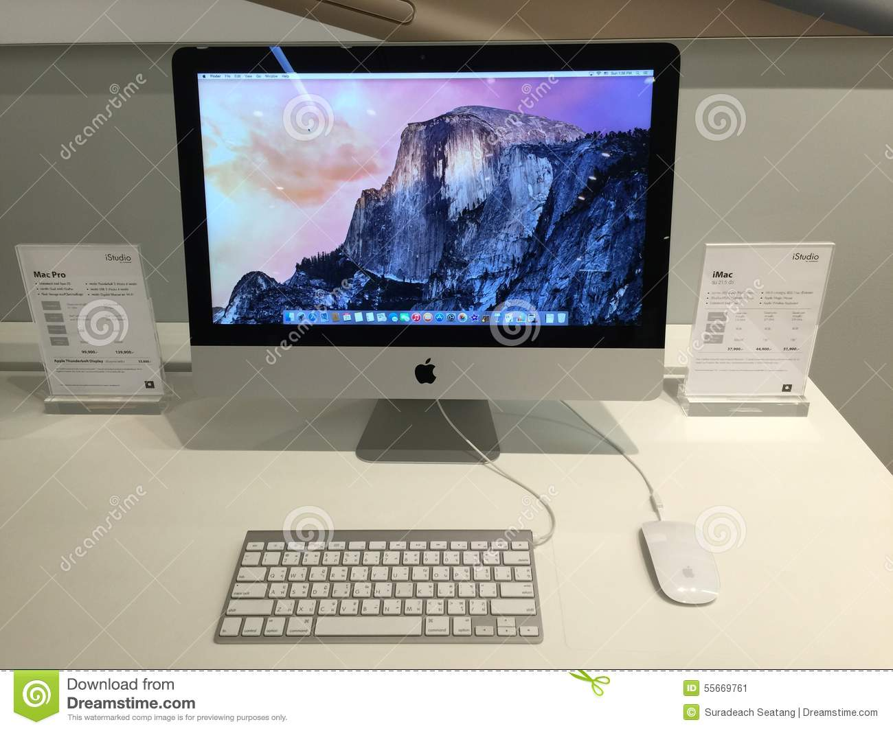 Apple mac on the table with price