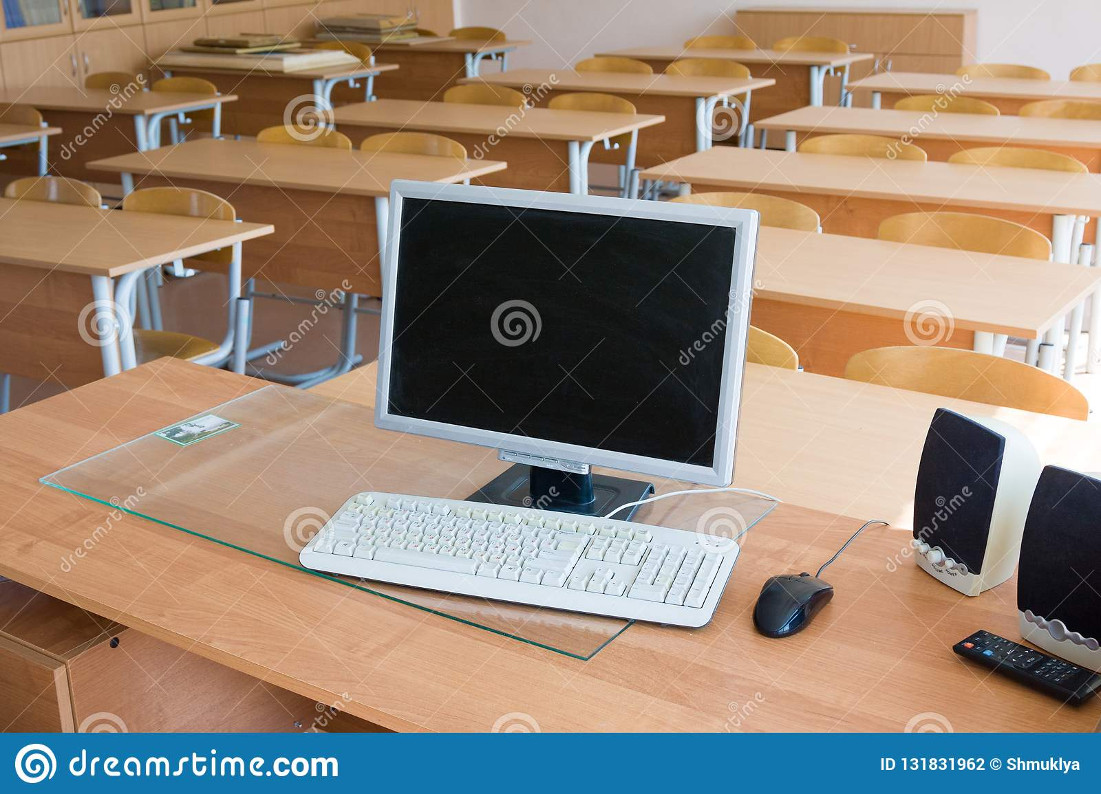 Computer on teacher`s table in auditorium