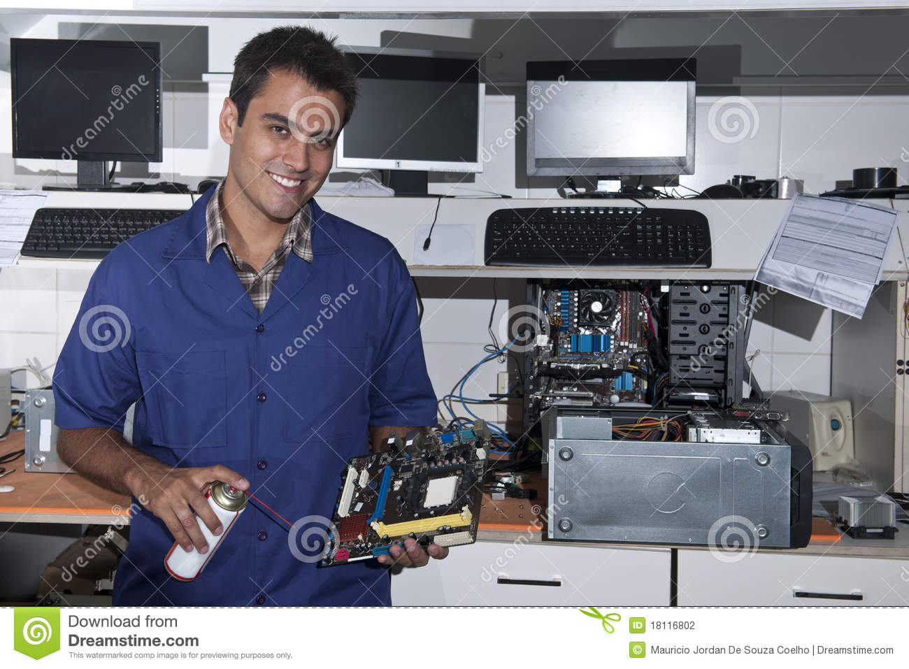 Computer Technician With Motherboard At Workshop Stock