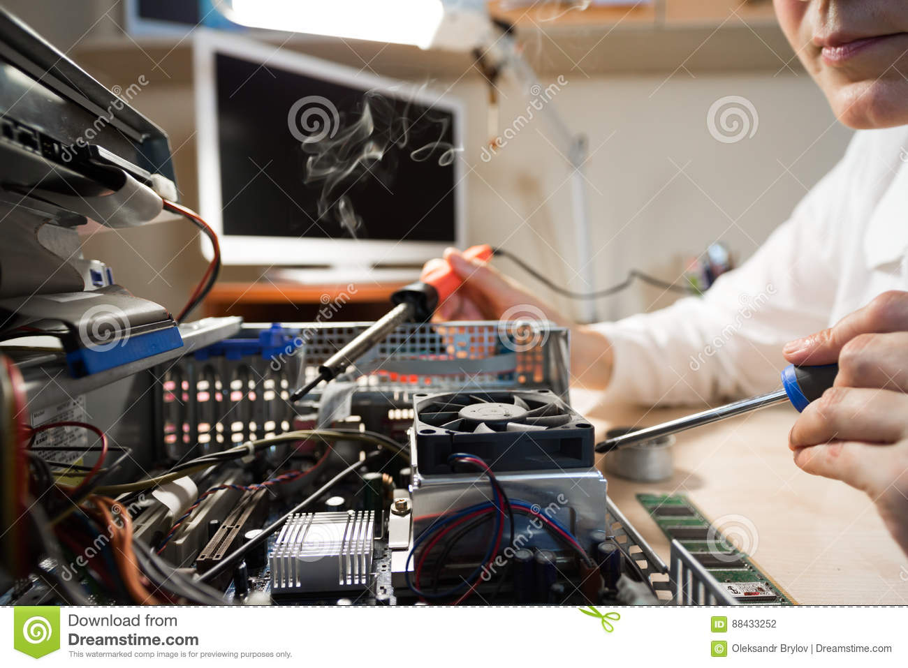 computer technician repairing hardware with tools stock