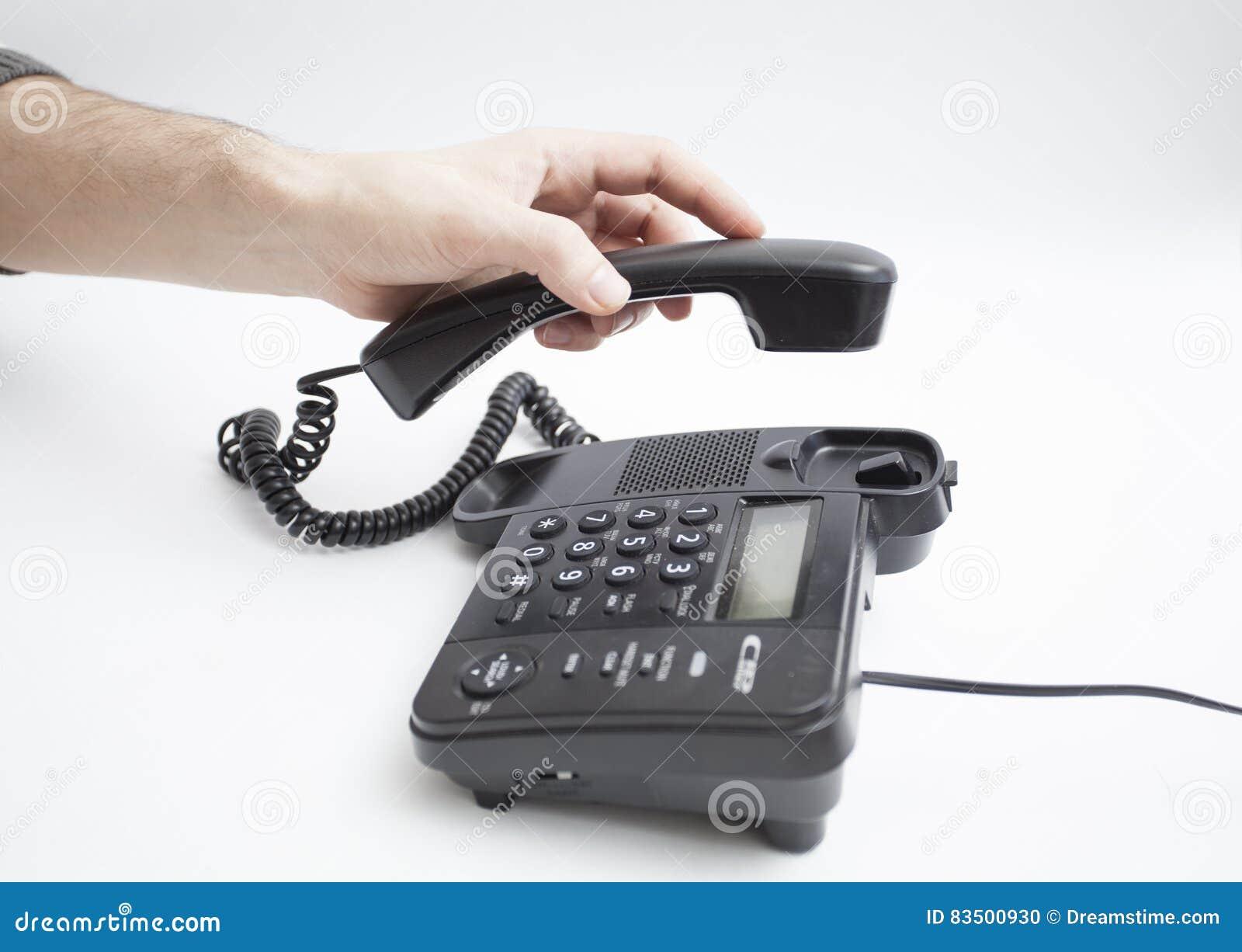 Con il braccio del microtelefono