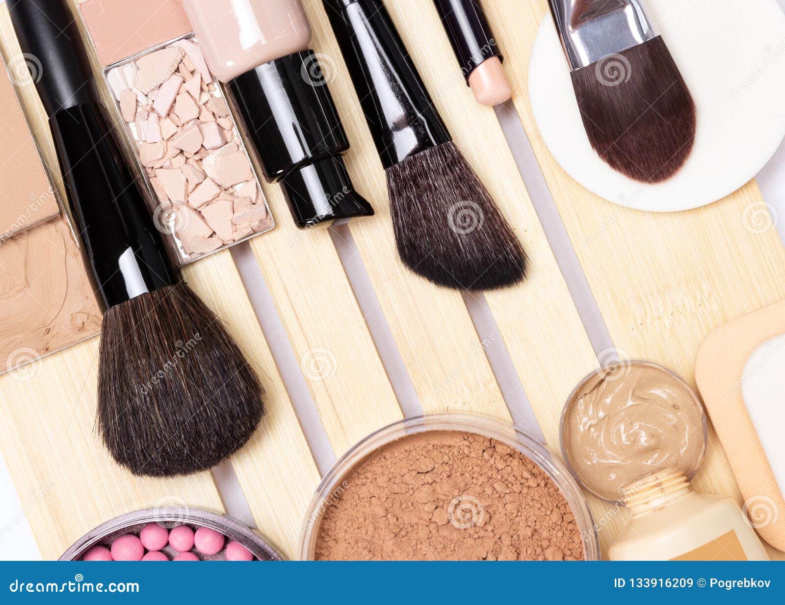 Concealer, primer, foundation, powder, blush with make-up brush