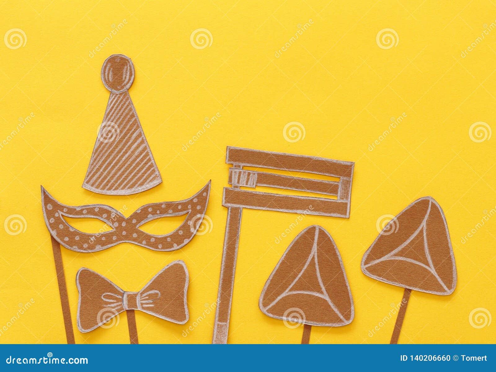 Conceito da celebração de Purim & x28; holiday& judaico x29 do carnaval; Formas tradicionais dos símbolos cutted do papel