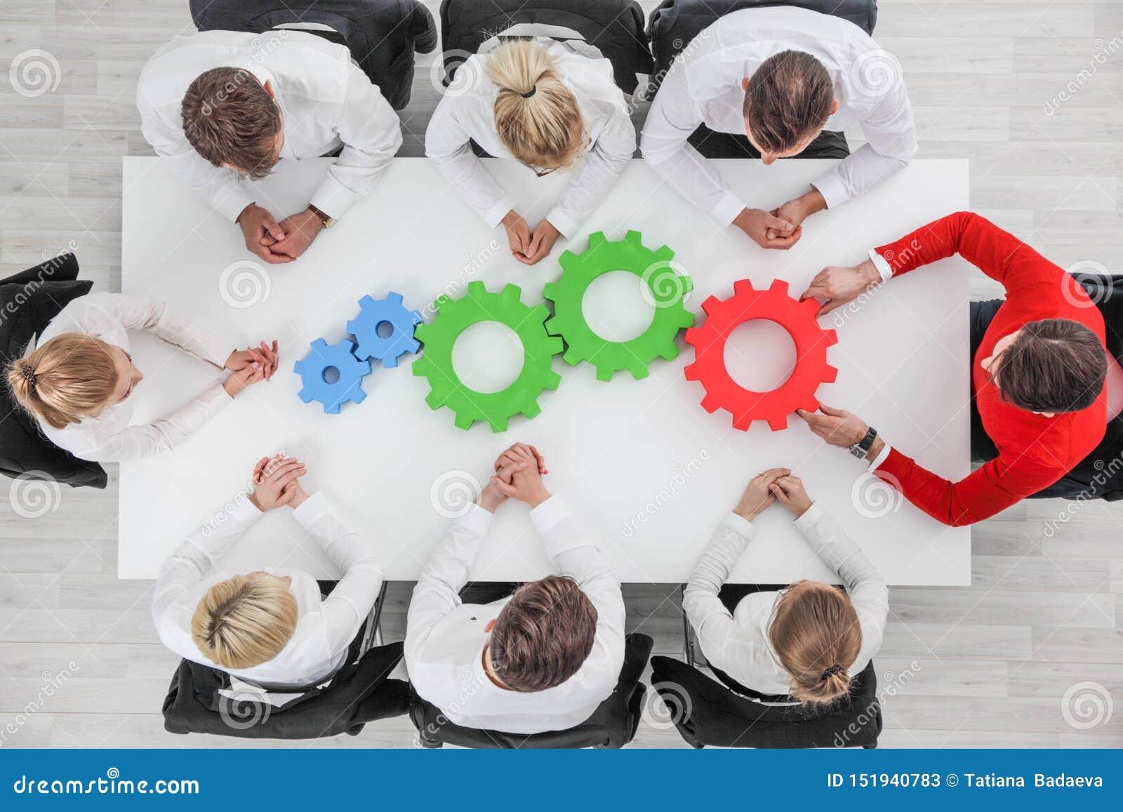 Conceito da cooperação da equipe do negócio