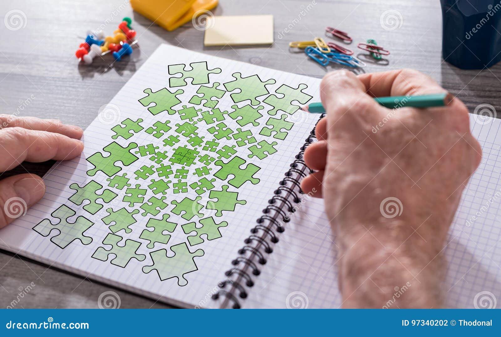 Conceito dos trabalhos de equipa em um bloco de notas