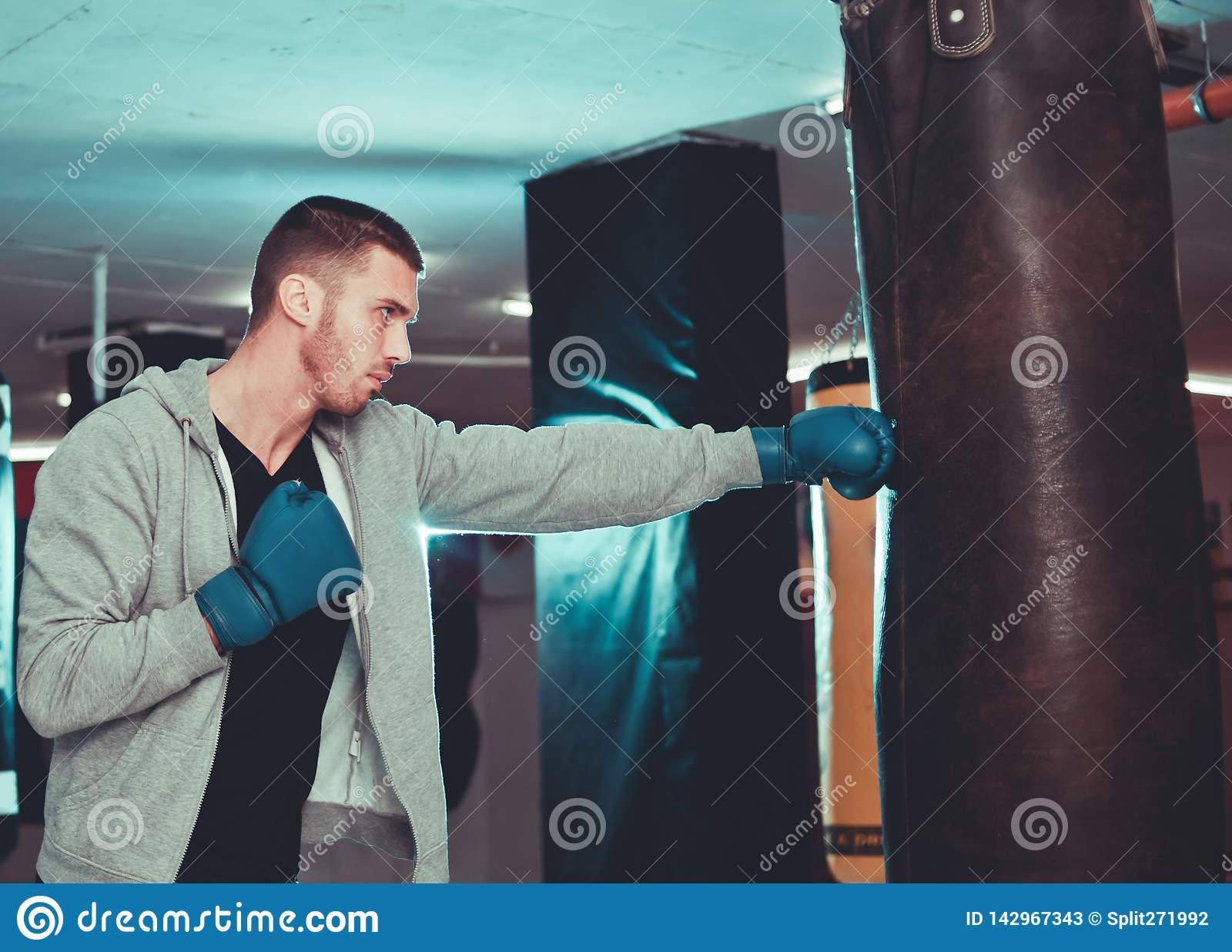 Concentrated boxer direct hit with punching bag