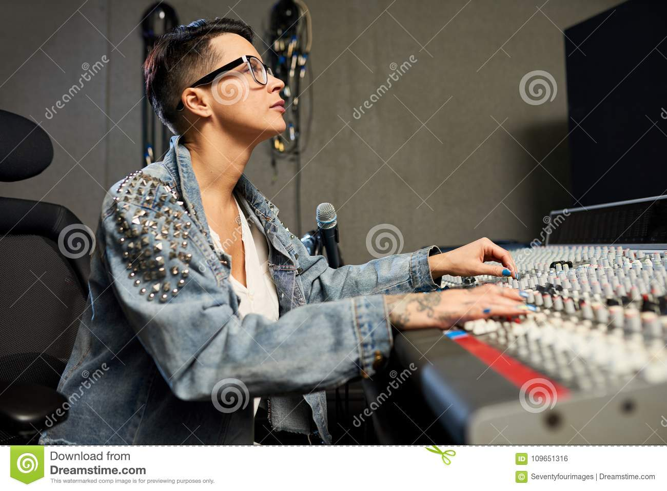 busy female audio engineer working  recording studio 1300 x 957 · jpeg