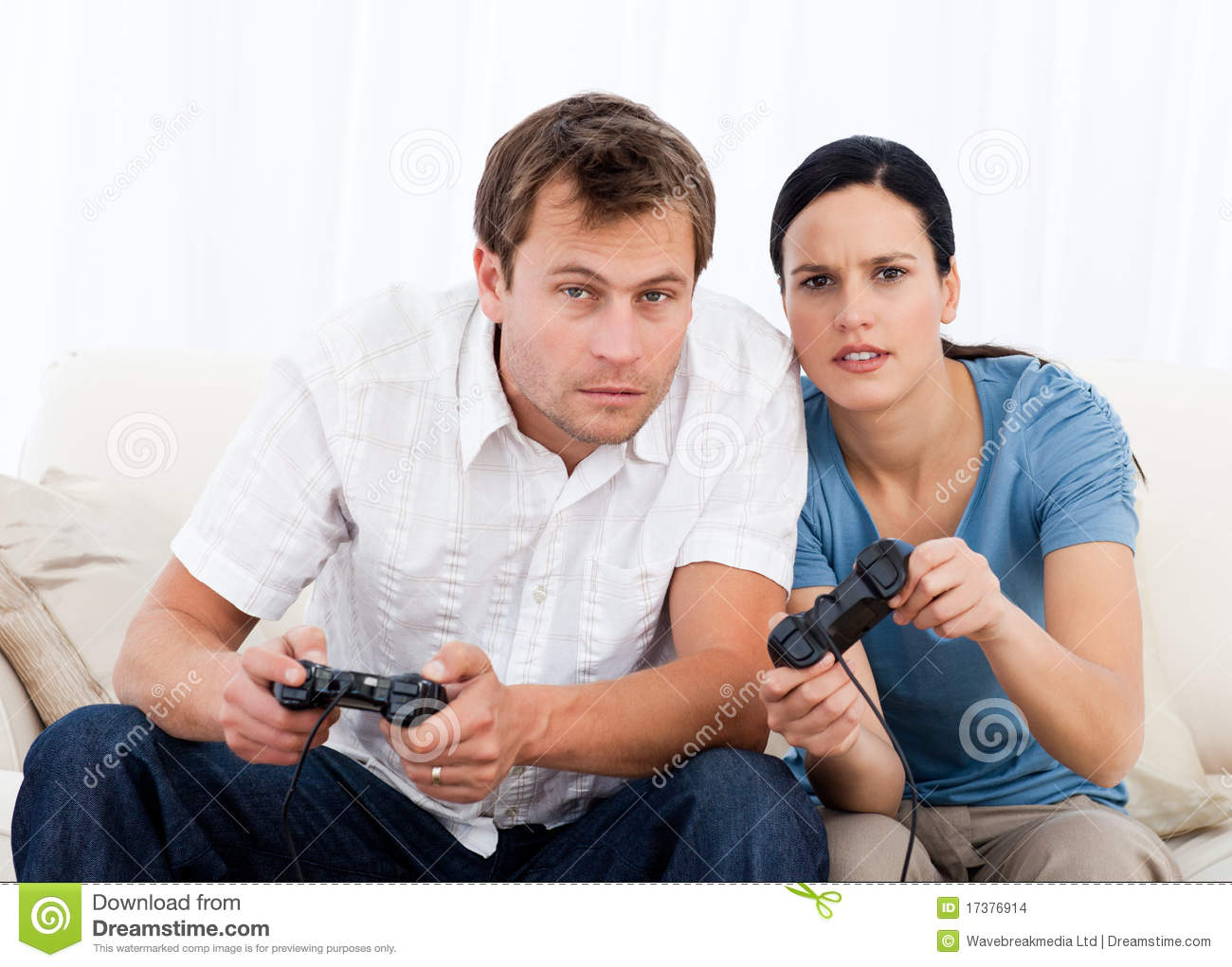 Concentrated Couple Playing Video Games Together Stock  : concentrated couple playing video games together 17376914 from www.dreamstime.com size 1300 x 1021 jpeg 127kB
