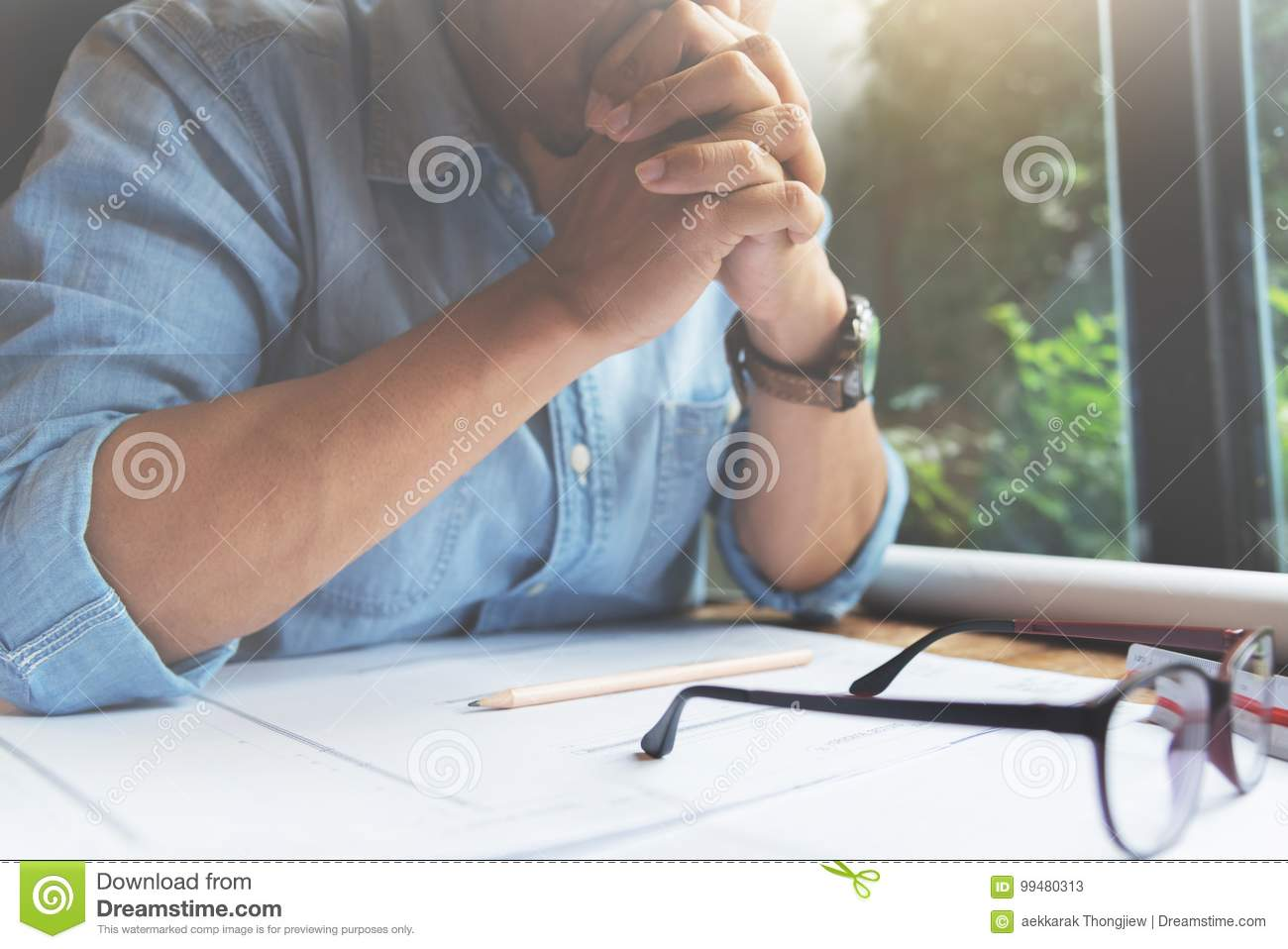 Concentrated of designer man thinking about his