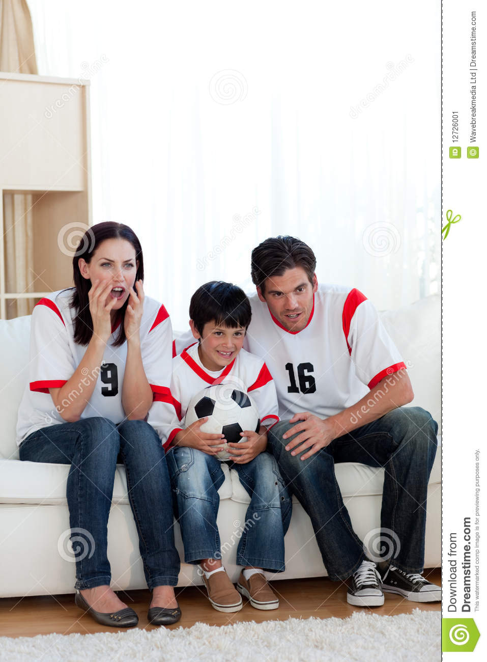 Concentrated Family Watching Football Match Stock Image ...
