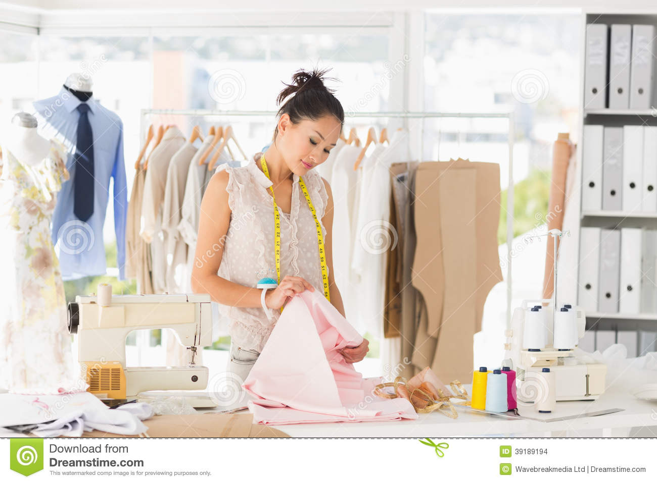 Concentrated Female Fashion Designer At Work Stock Photo