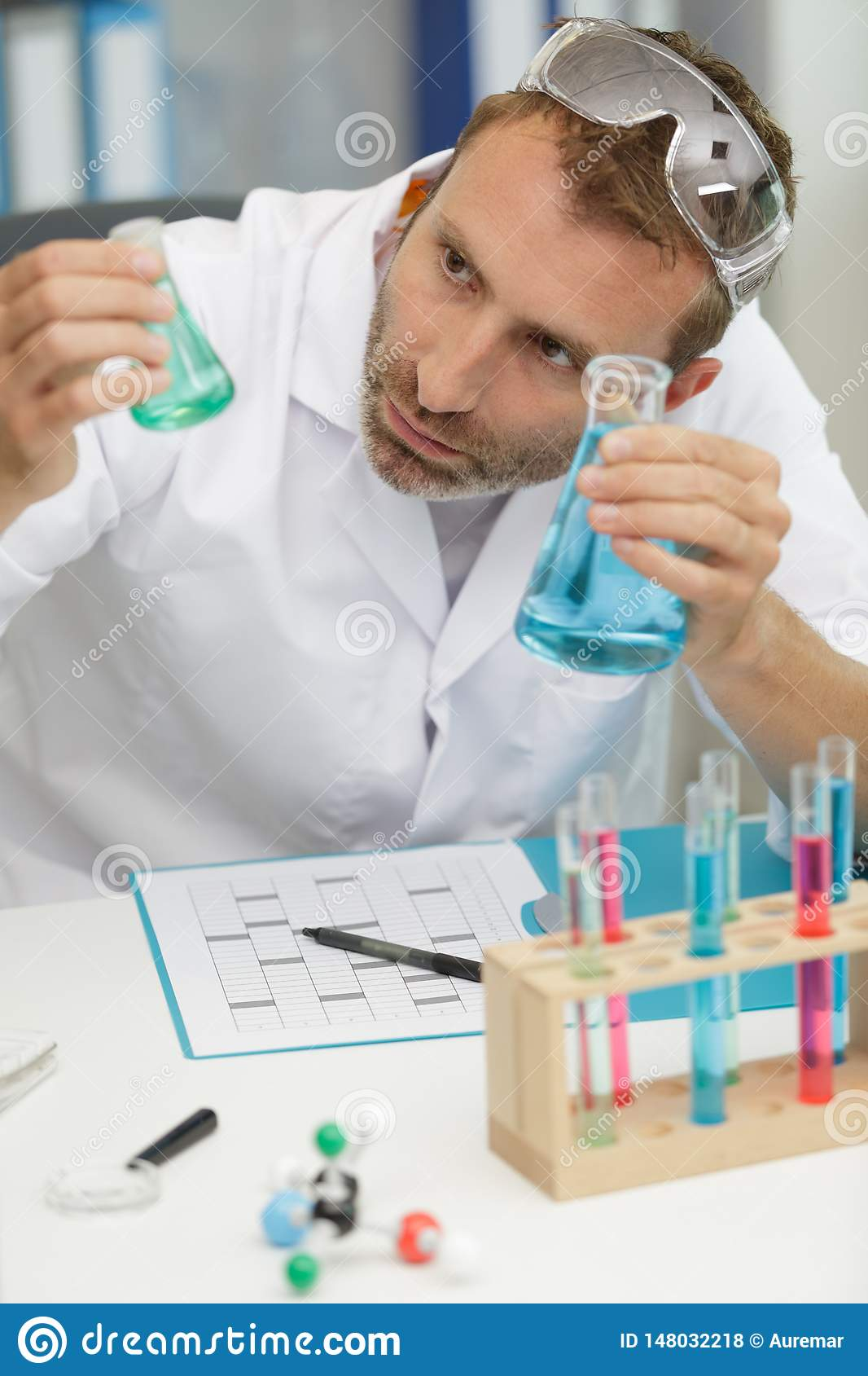 Concentrated lab worker making experiment