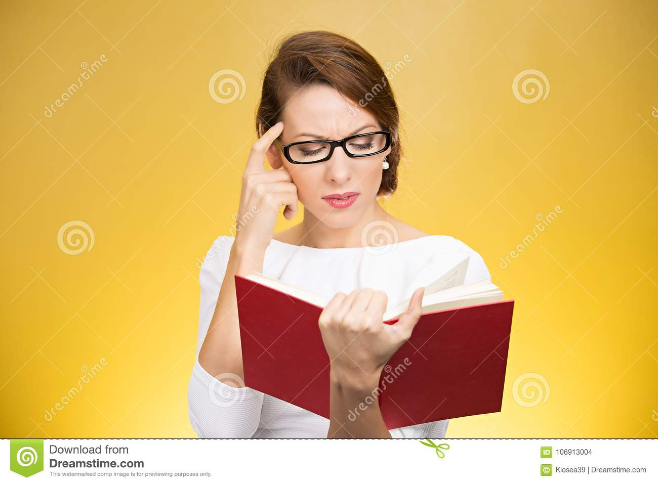 Concentrated woman thinking on book content