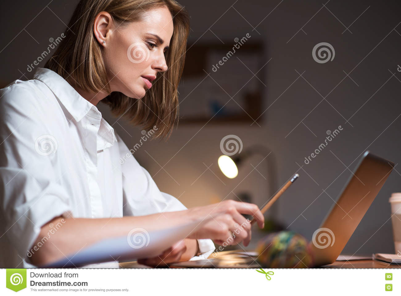 Concentrated woman working on a laptop