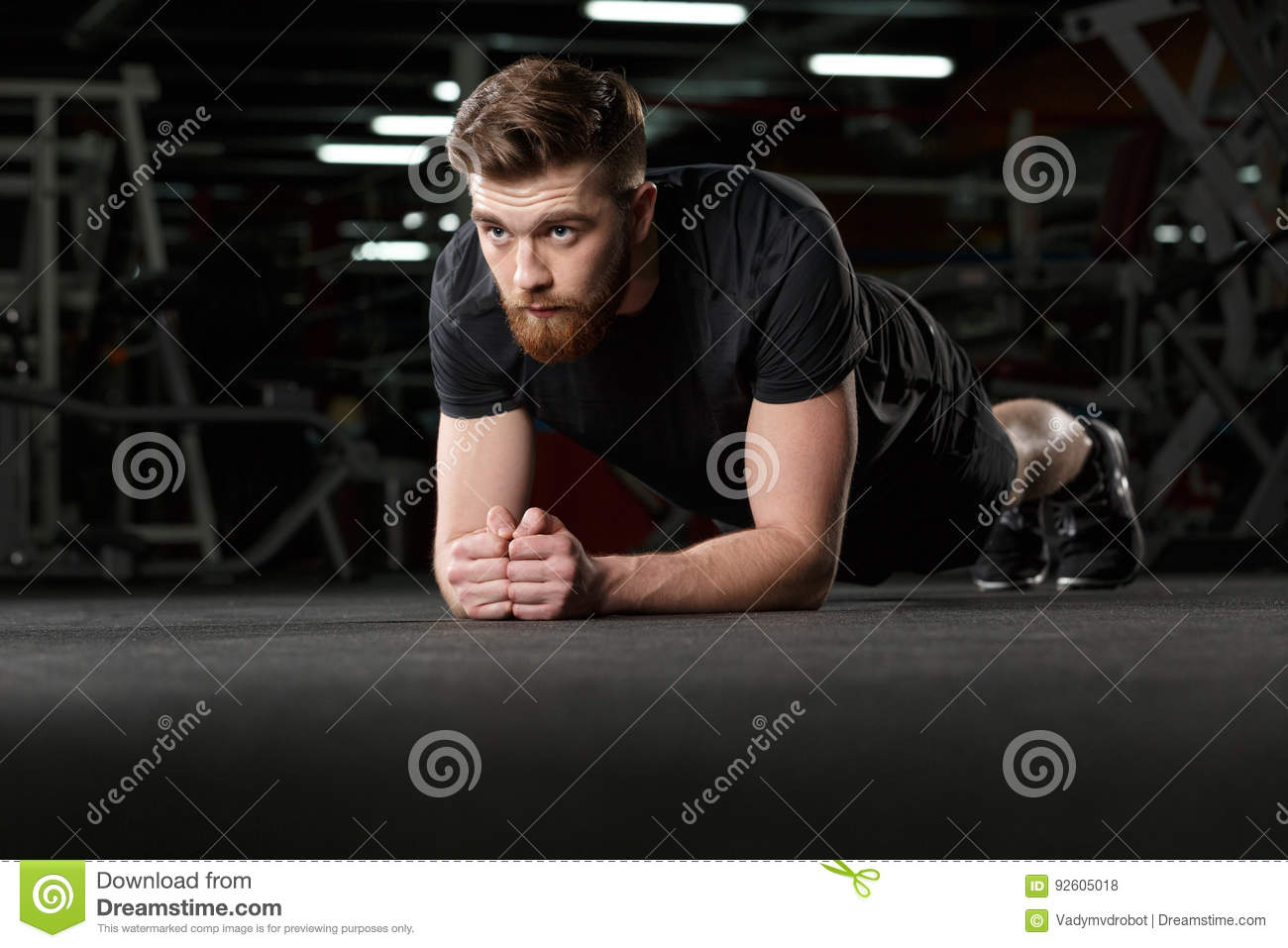 Concentrated young strong sports man make plank