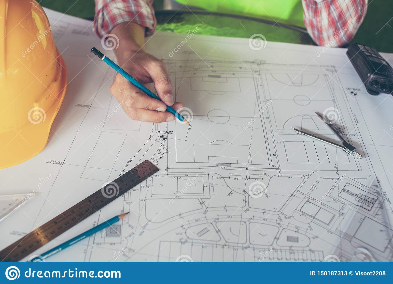 Concept architects,engineer holding pen pointing equipment architects On the desk with a blueprint in the office, Vintage, Sunset