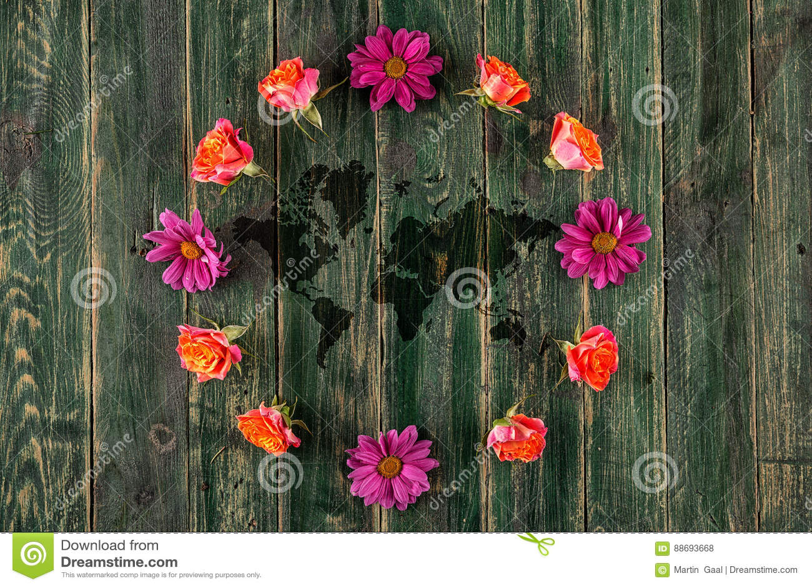 concept avec la terre et les fleurs colorées autour, la terre de