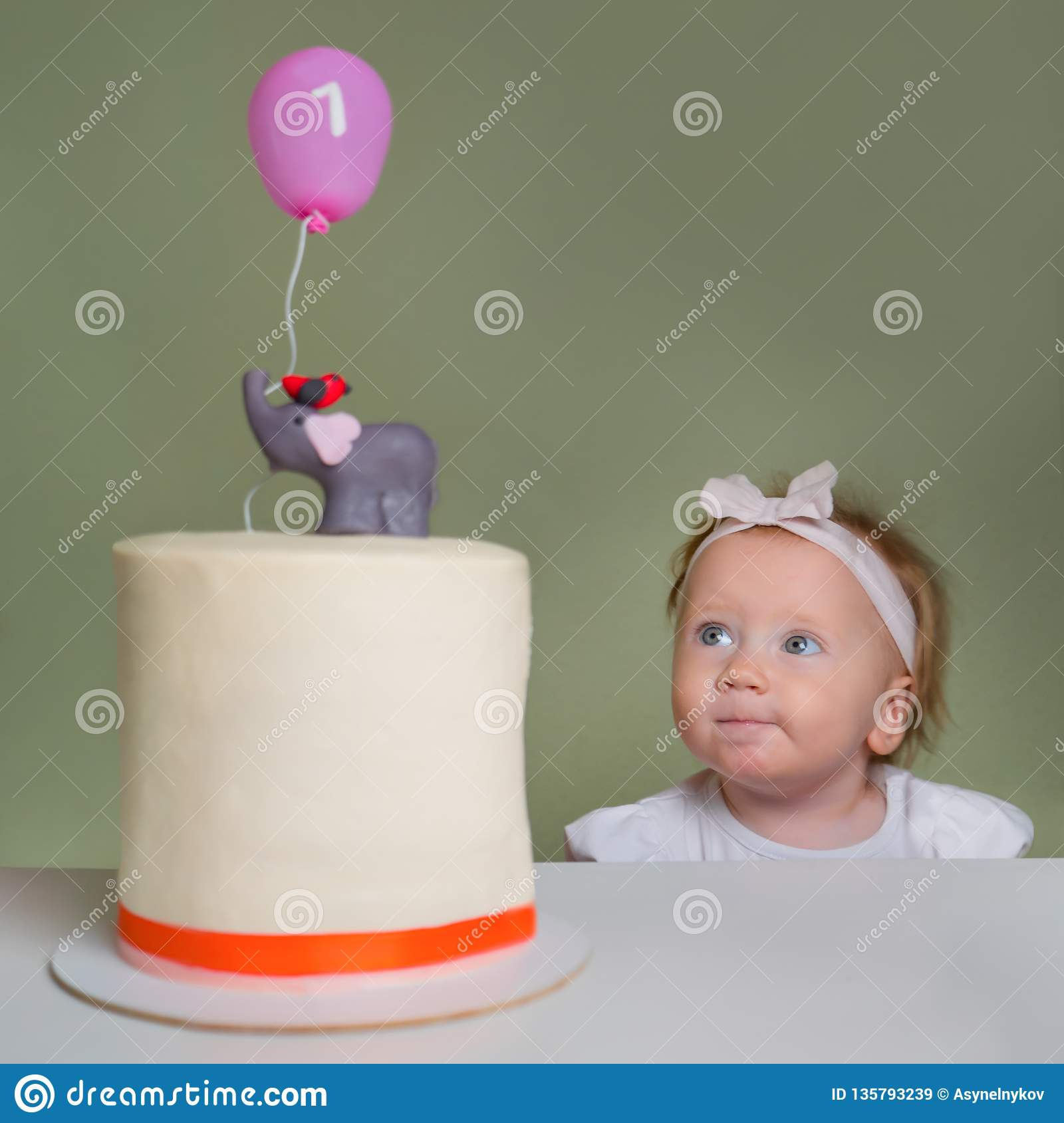 Baby Girl Looking On Birthday Stollen Cake Positive Emotions The Face Of Little At With Number One It