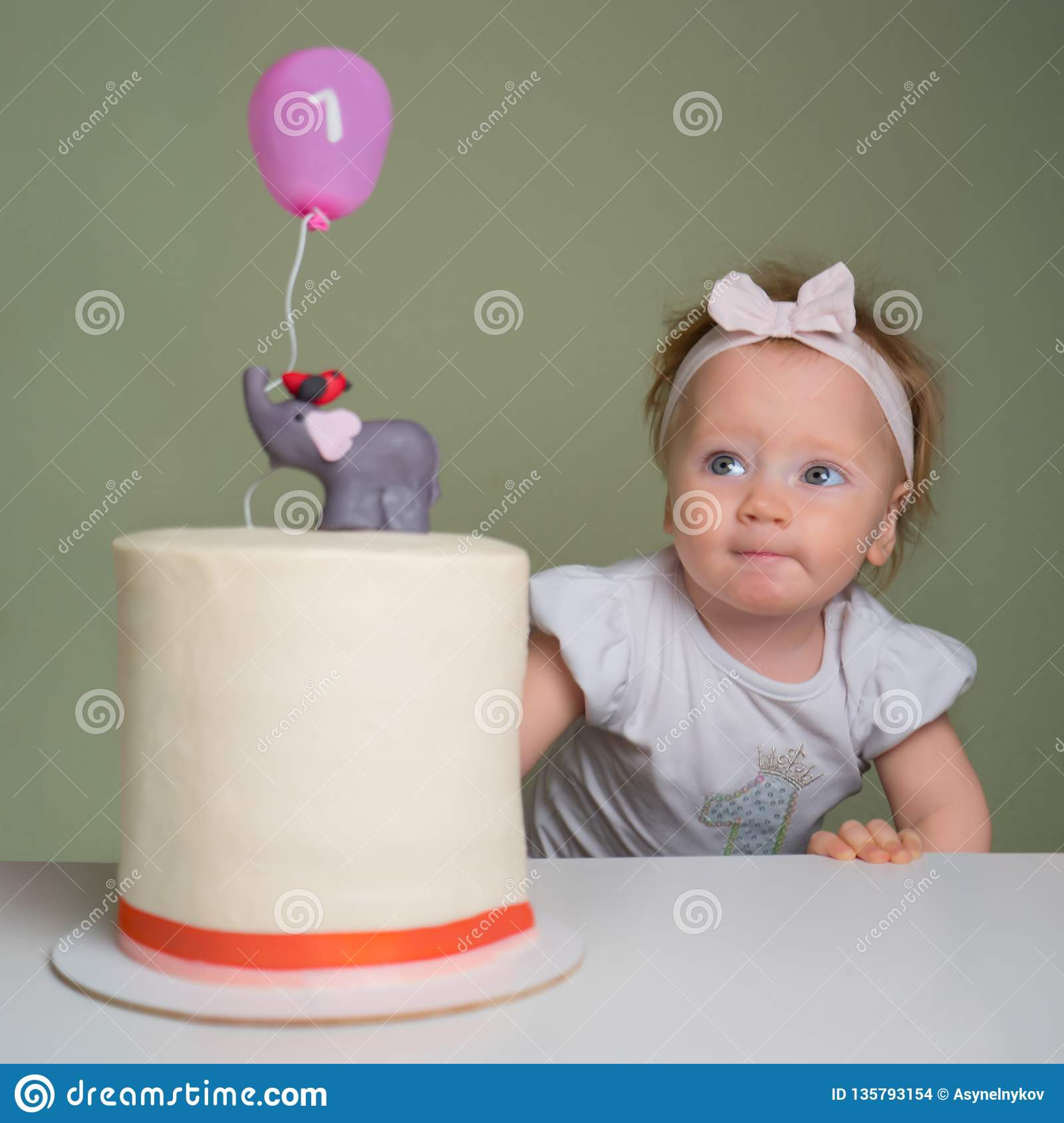 Positive Emotions On The Face Of Little Girl Looking At Birthday Cake With Number One It Smiling Toddler Pie