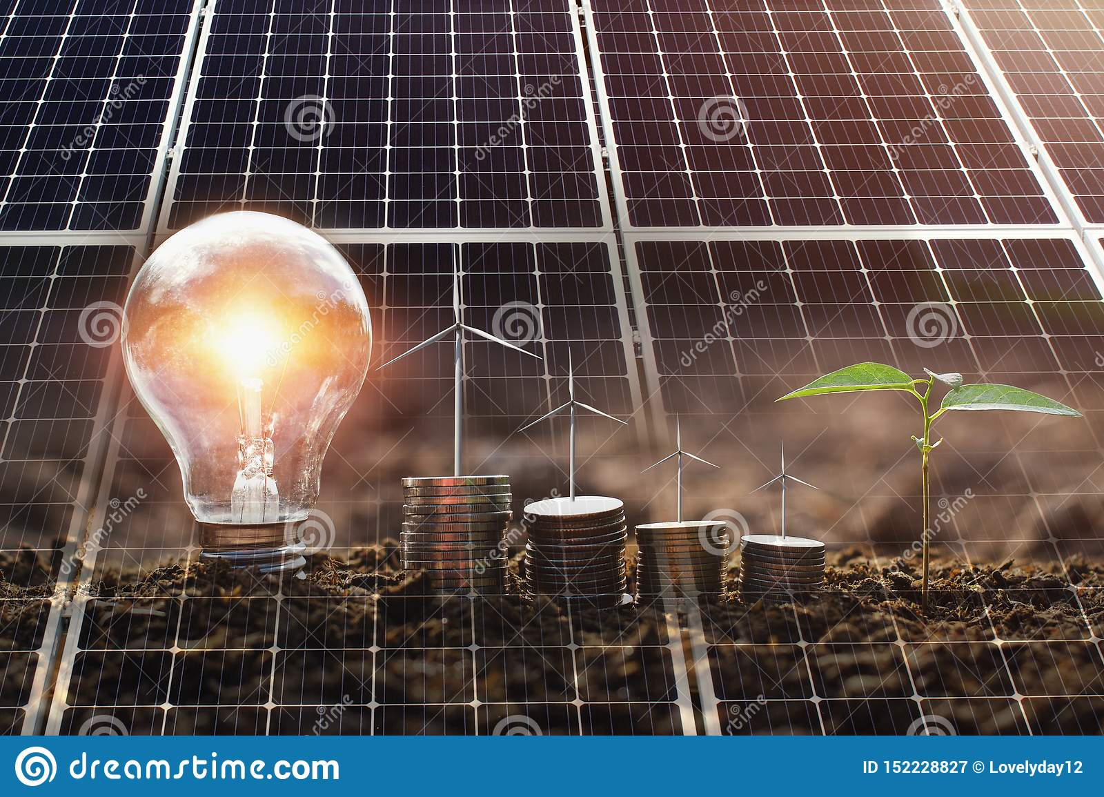 concept clean energy and saving power in nature. solar panel with wind turebine on money and lightbulb