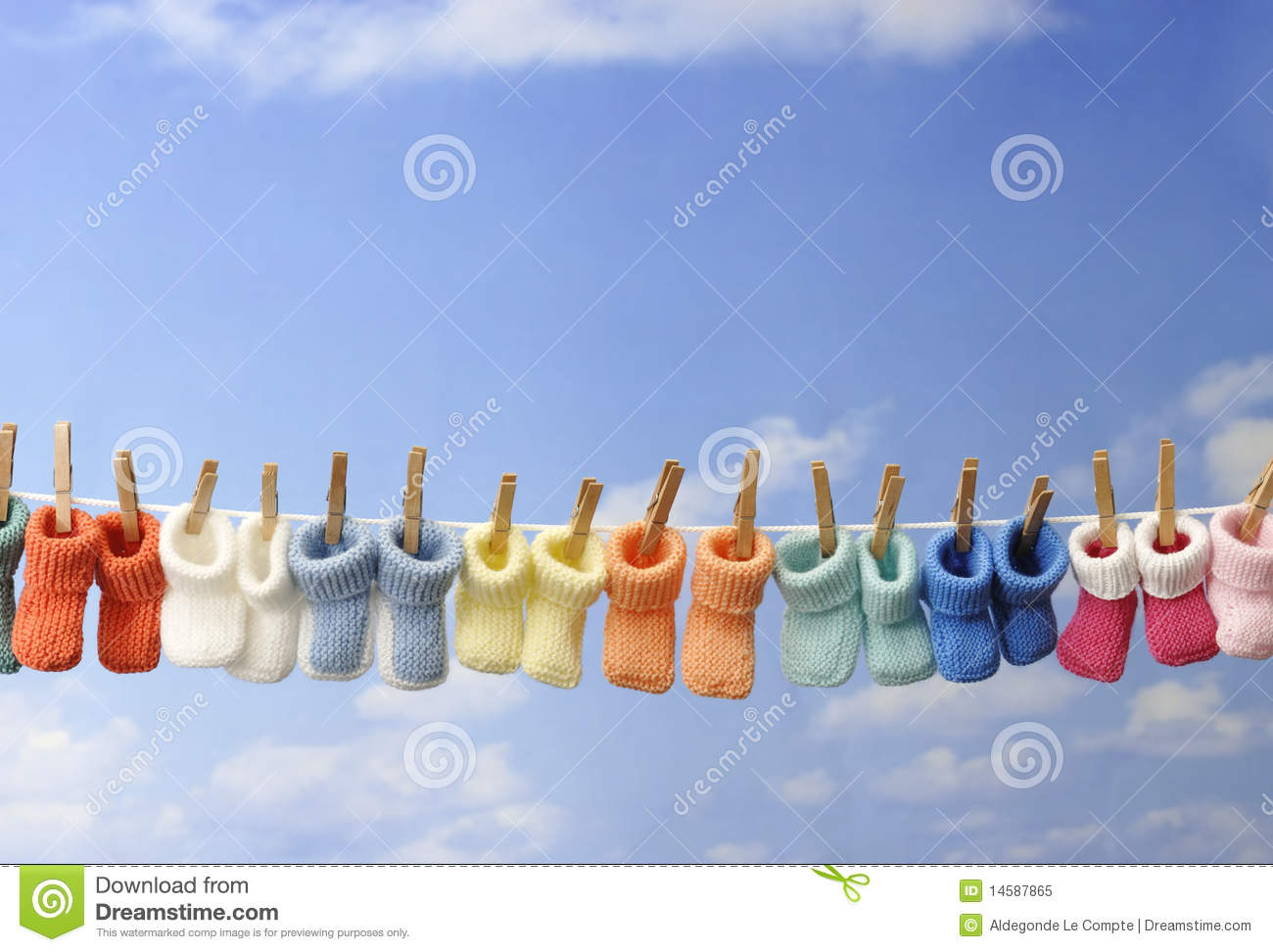Concept colorful baby booties on a clothes line royalty free stock photo image 14587865