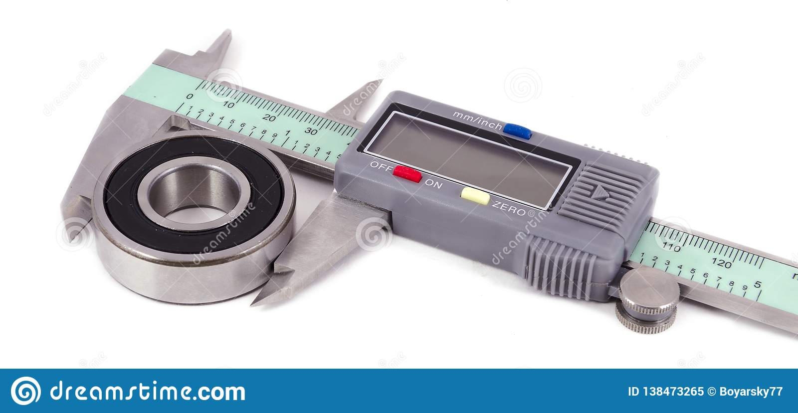 Bearing and electronic caliper on a white background
