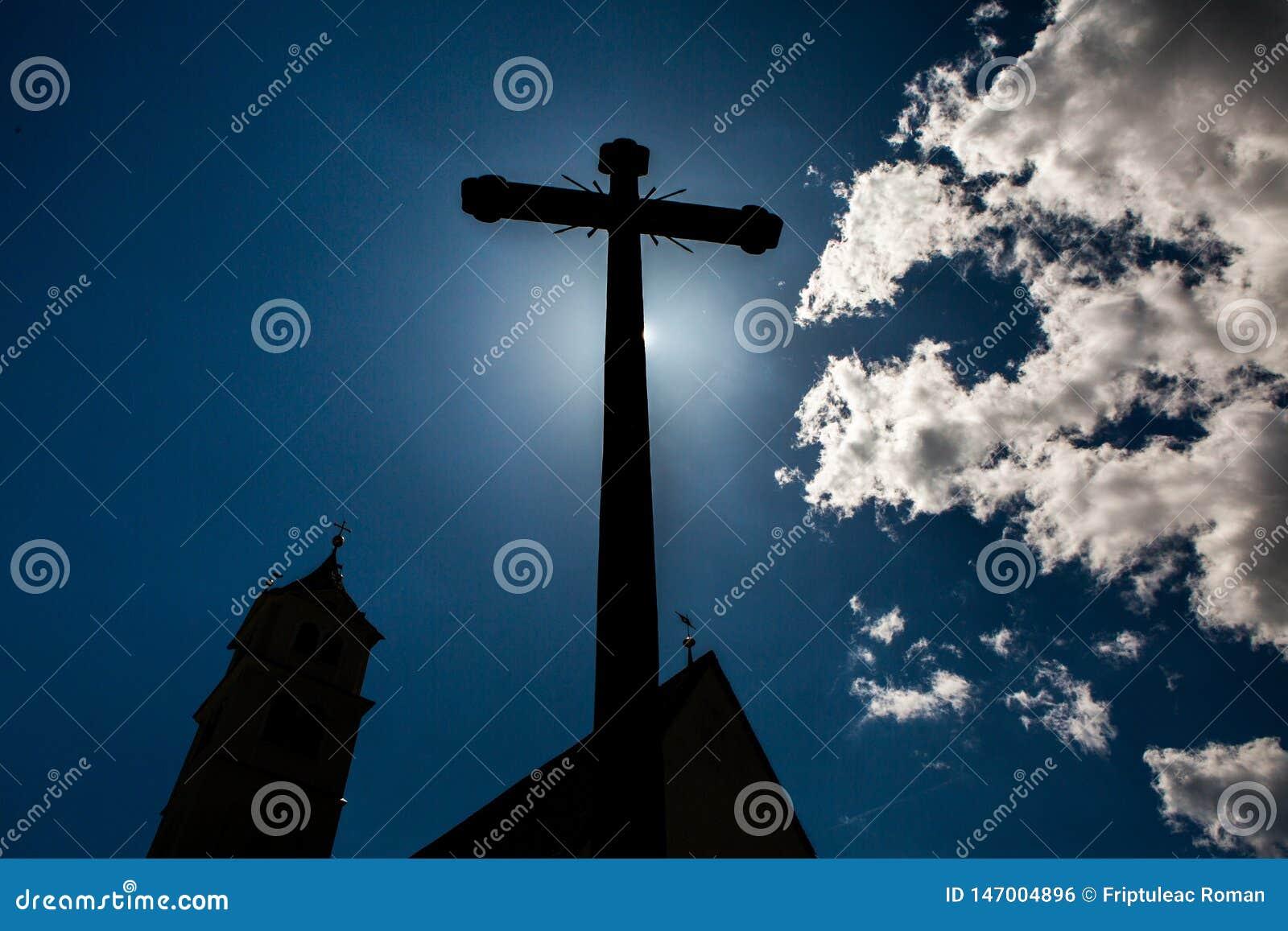 Concept cross religion symbol silhouette over sky. Christian religion background concept. The cross symbol for Jesus Christ.