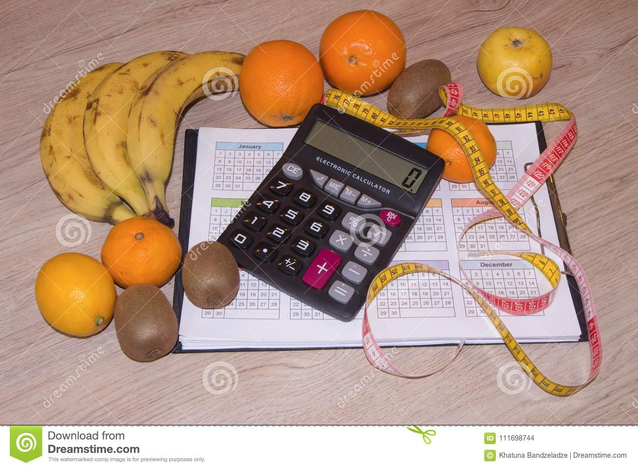 products with low fat content fruits and measuring tape stock photo