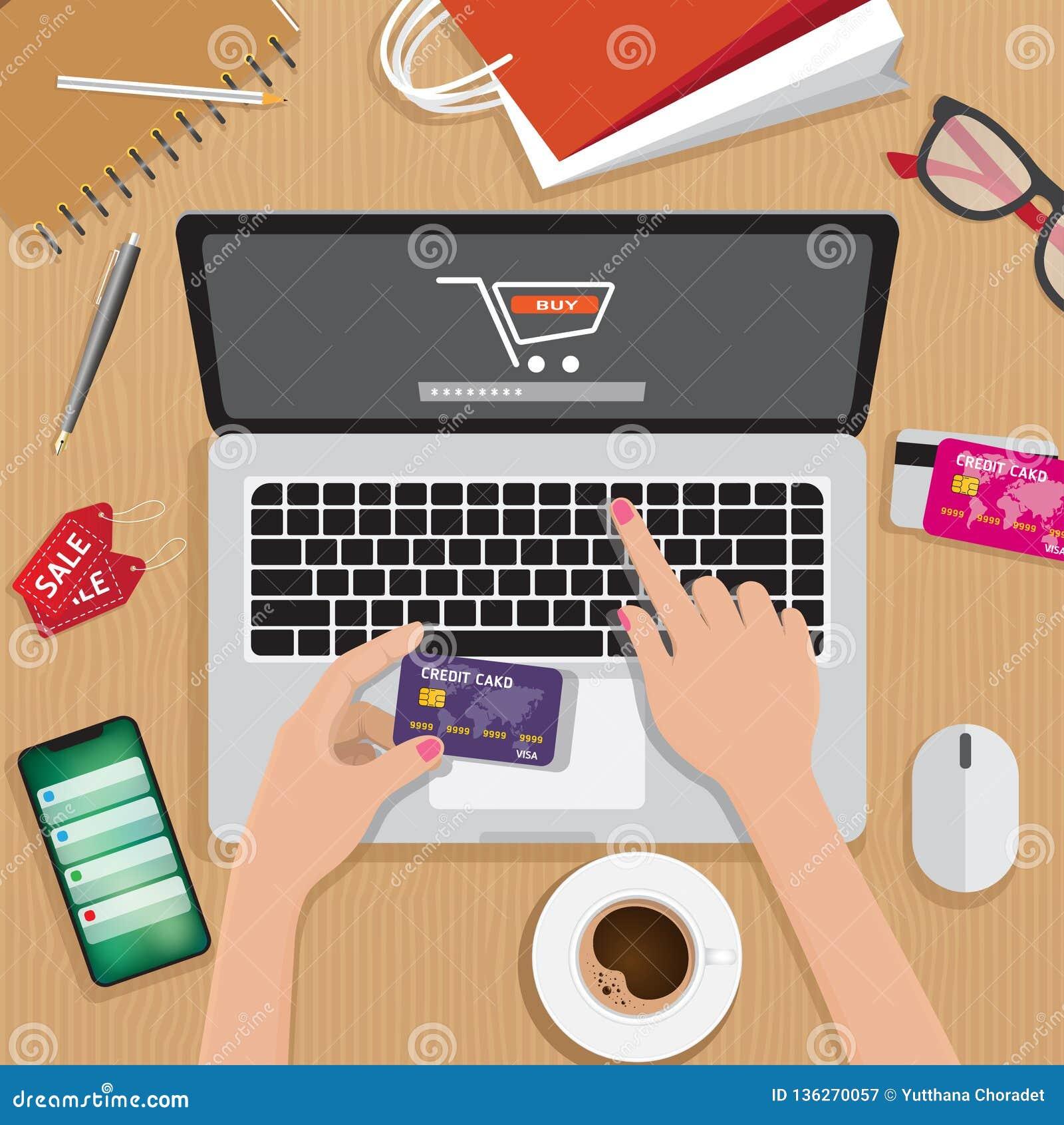 Concept en ligne d achats, d e-paiement, de vente au détail et de livraison, ordinateur portable avec le caddie au centre