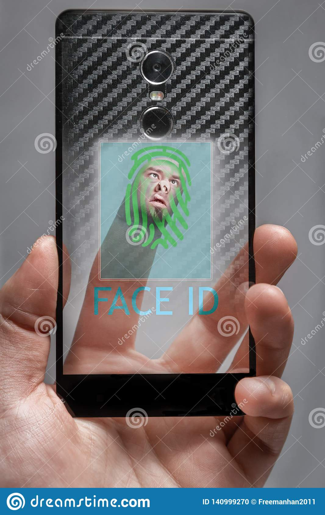 The concept of Face ID . the face on the finger touches the sensor biometrics on the phone screen
