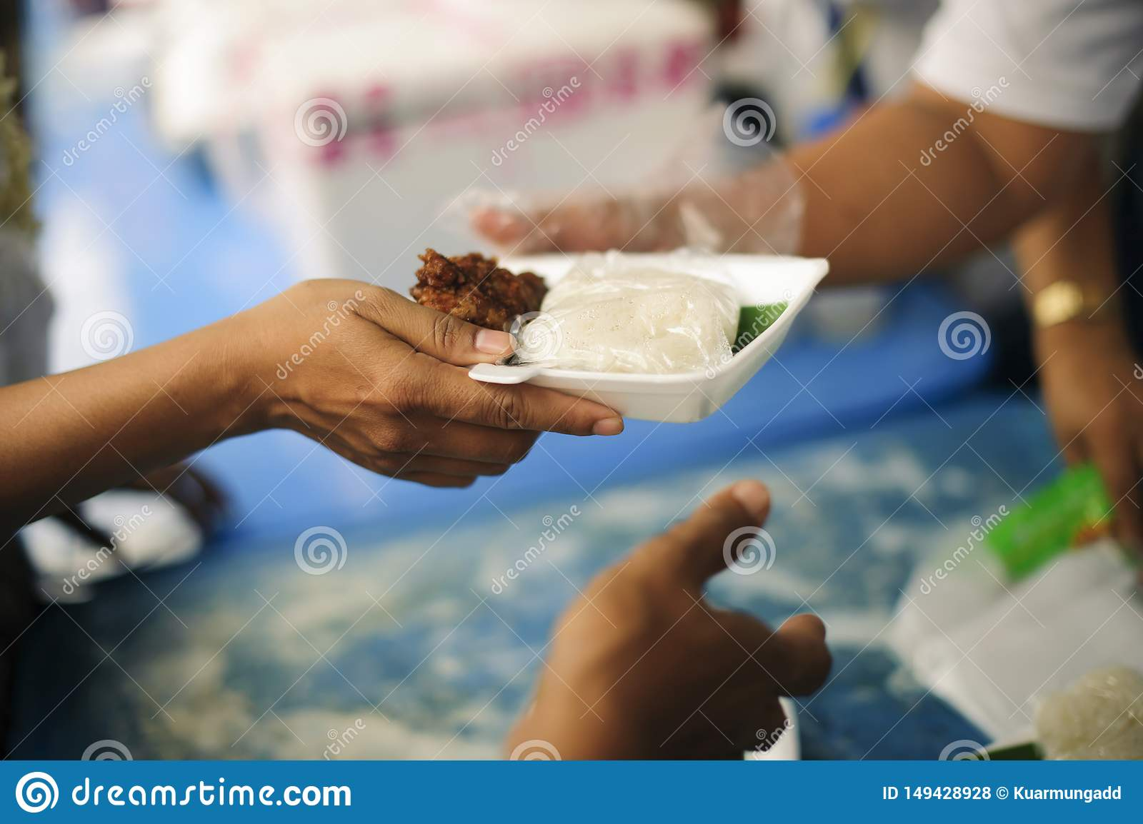 Concept of food sharing for the poor to alleviate hunger : Social Problems of Poverty Helped by Feeding : Donate food to people in