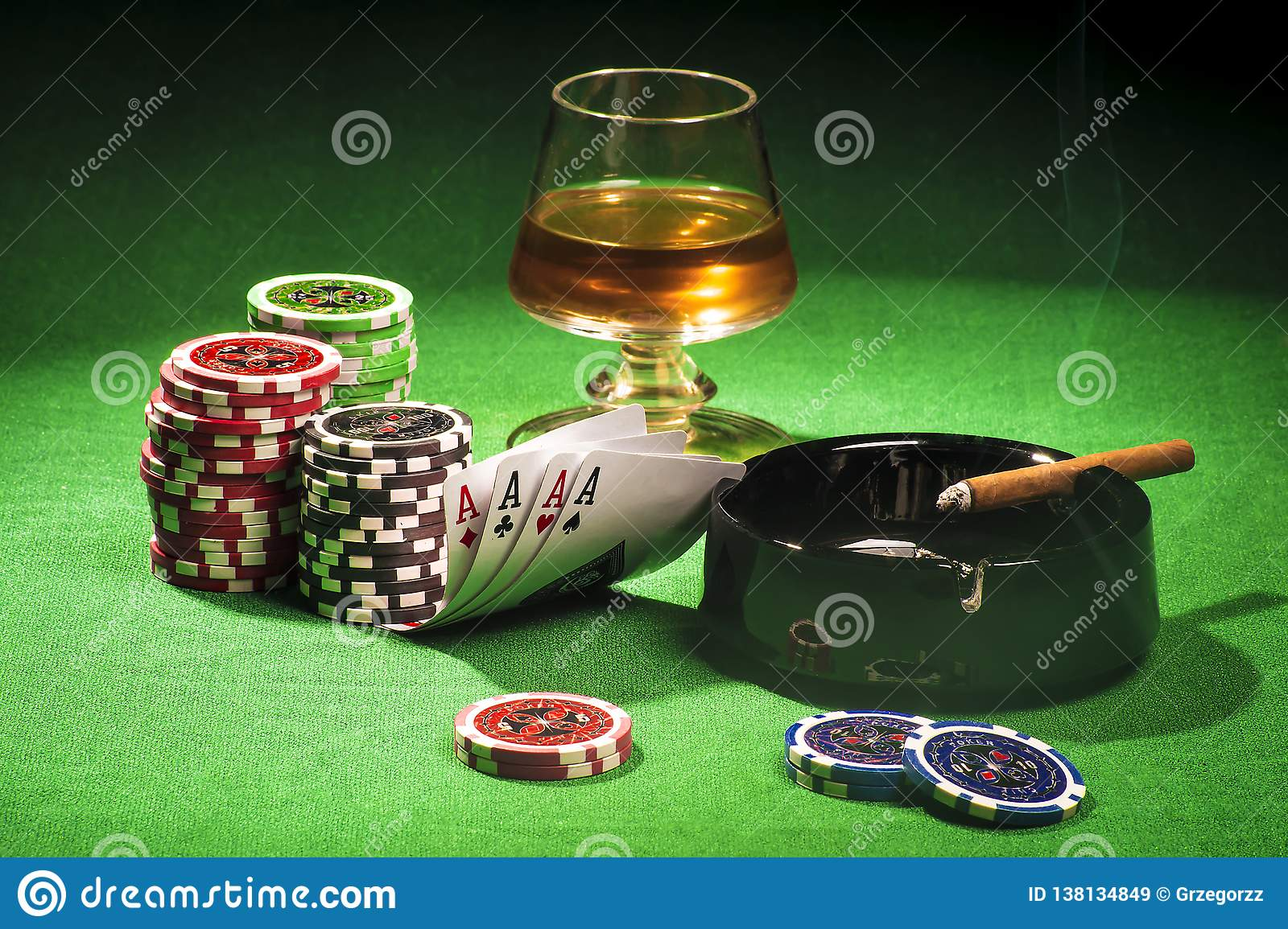 The concept of gambling, cards and chips with a glass of cognac and a cigar