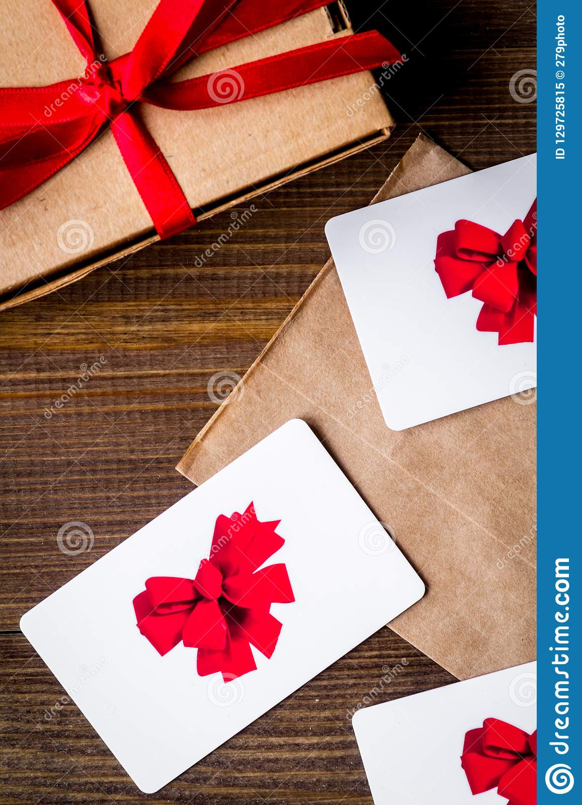 concept of gift cards on wooden background top view stock