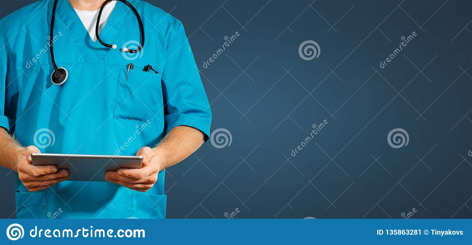 Concept of global medicine and healthcare. Unrecognizable doctor using digital tablet. Diagnostics and modern technology on blue