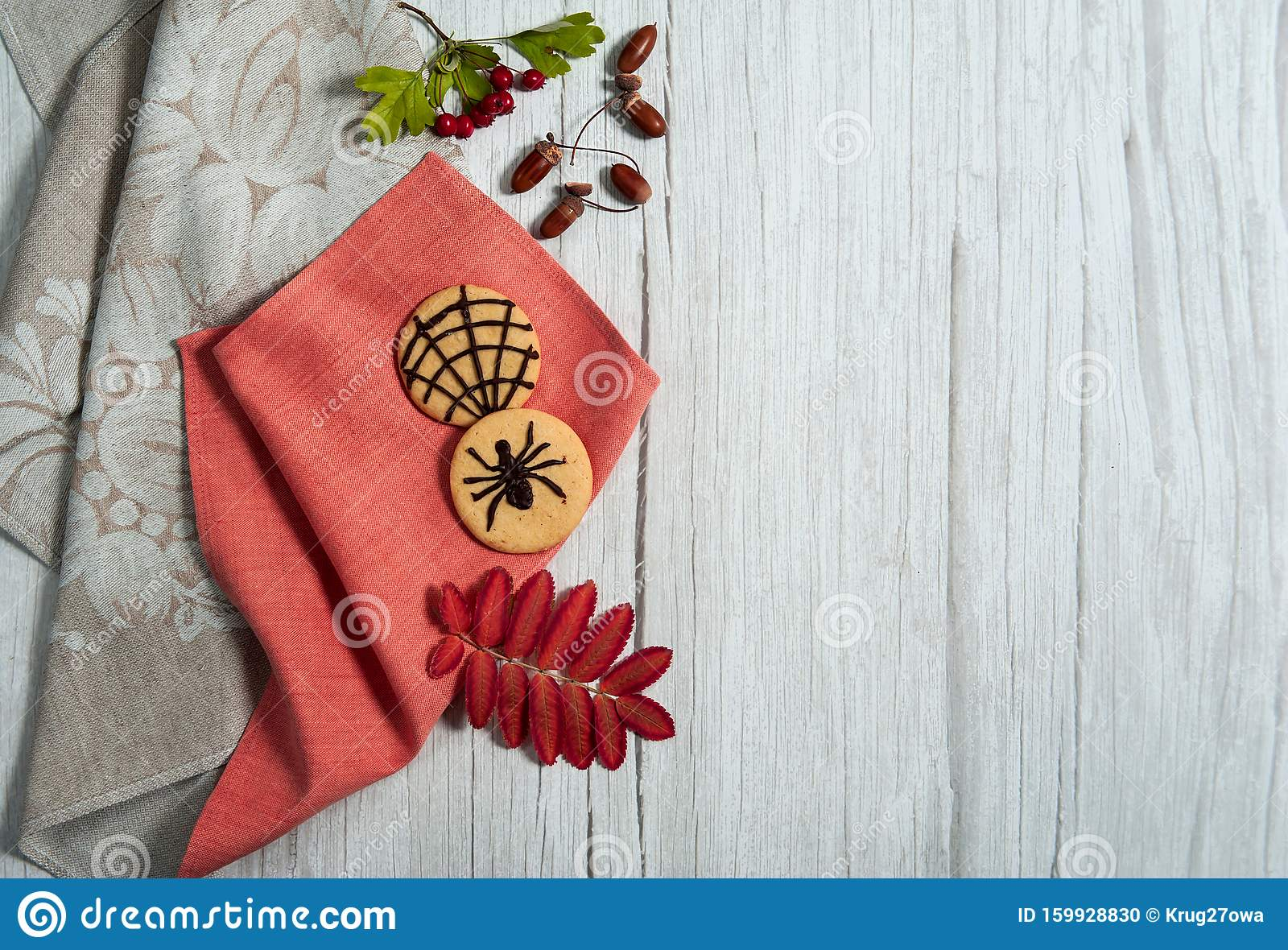 Homemade Cookies With Chocolate Spiders Hawthorn Berries Rowan Leaves Acorns Two Linen Napkins On A Light Wooden Background Stock Photo Image Of Creepy Close 159928830
