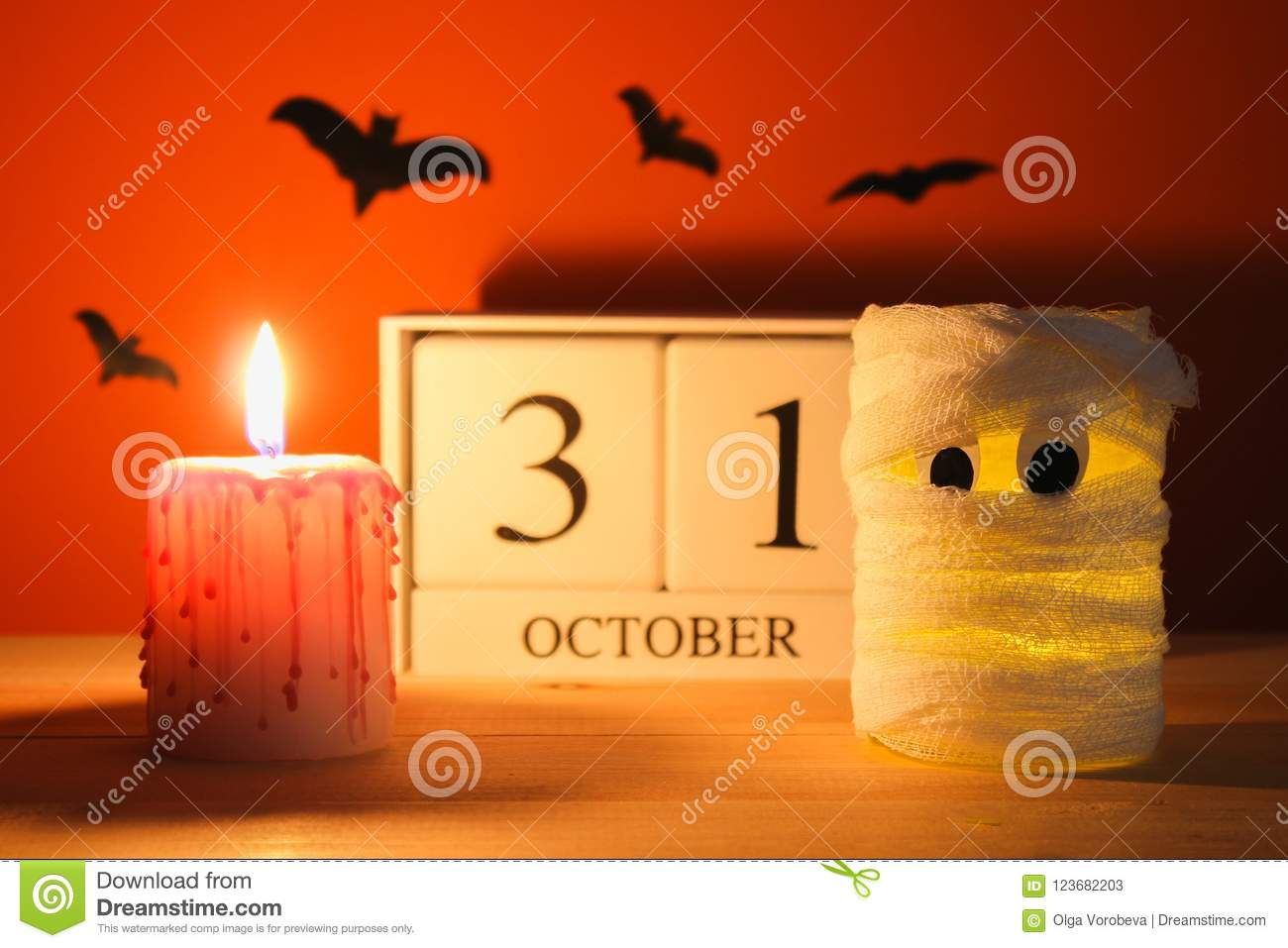 The concept for Halloween. Mummy from a can, gauze and candles, a wooden calendar showing October 31.
